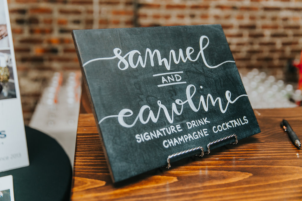 Reusing Chalk Signs - Here's a tip. If you're going to have a wooden sign created for your wedding that you won't want to display in your home after the big day, consider using chalkboards. Chalkboards and weddings just go together. We use chalk markers on our chalkboards because they are semi-perminant meaning they won't easily smudge like chalk. After the event, wash and dry the board then apply a fresh coat of chalkboard paint (available at any craft store). And you're done!