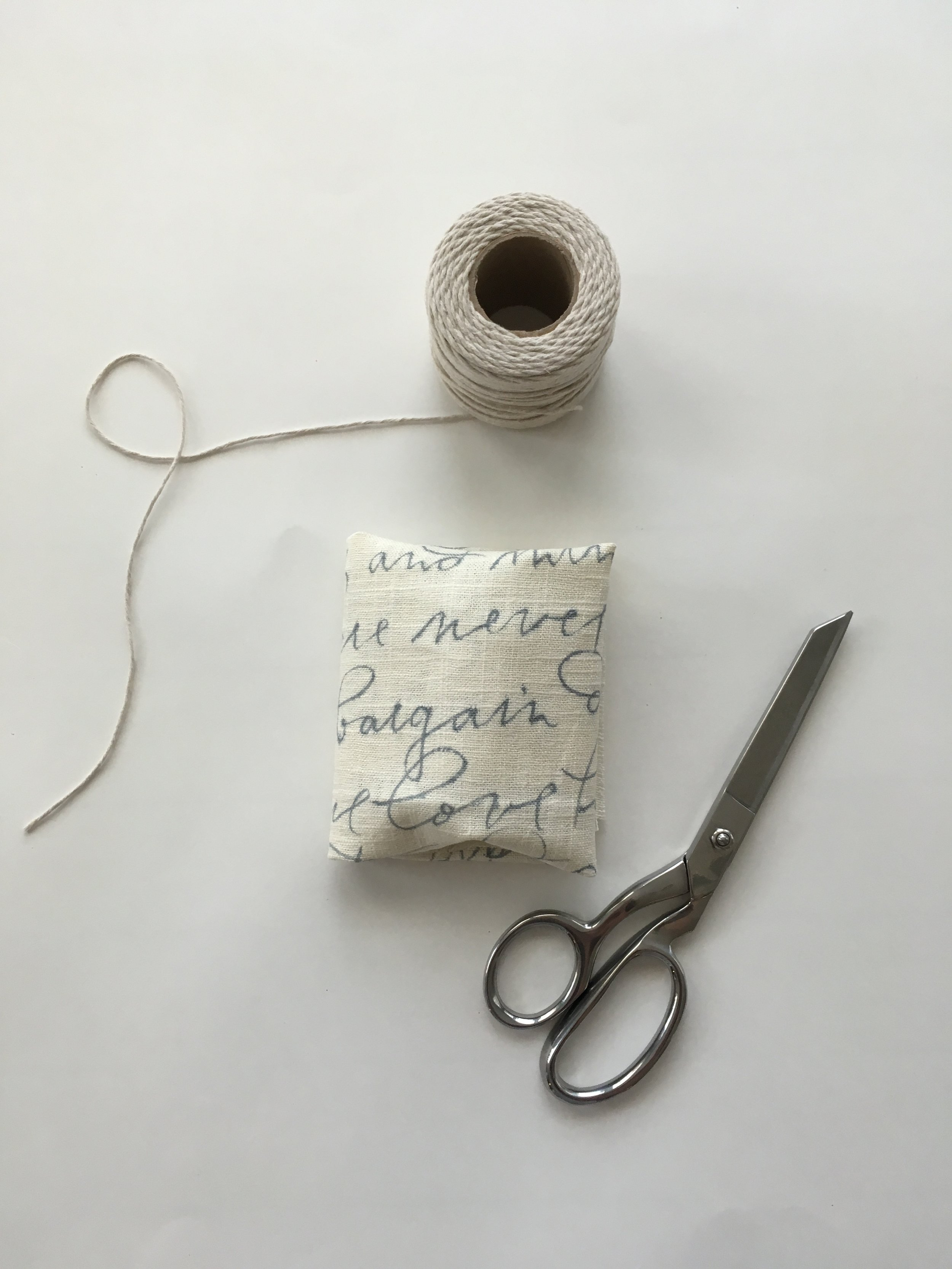 Step 7. - TIE. Tie up your sweet gift with ribbon or twine. Now you're ready to give! Fabric makes gifting small tokens or handmade gifts even more personal. Hostess gifts, housewarming, wedding or anniversary gifts are all great occasions for wrapping with fabric.