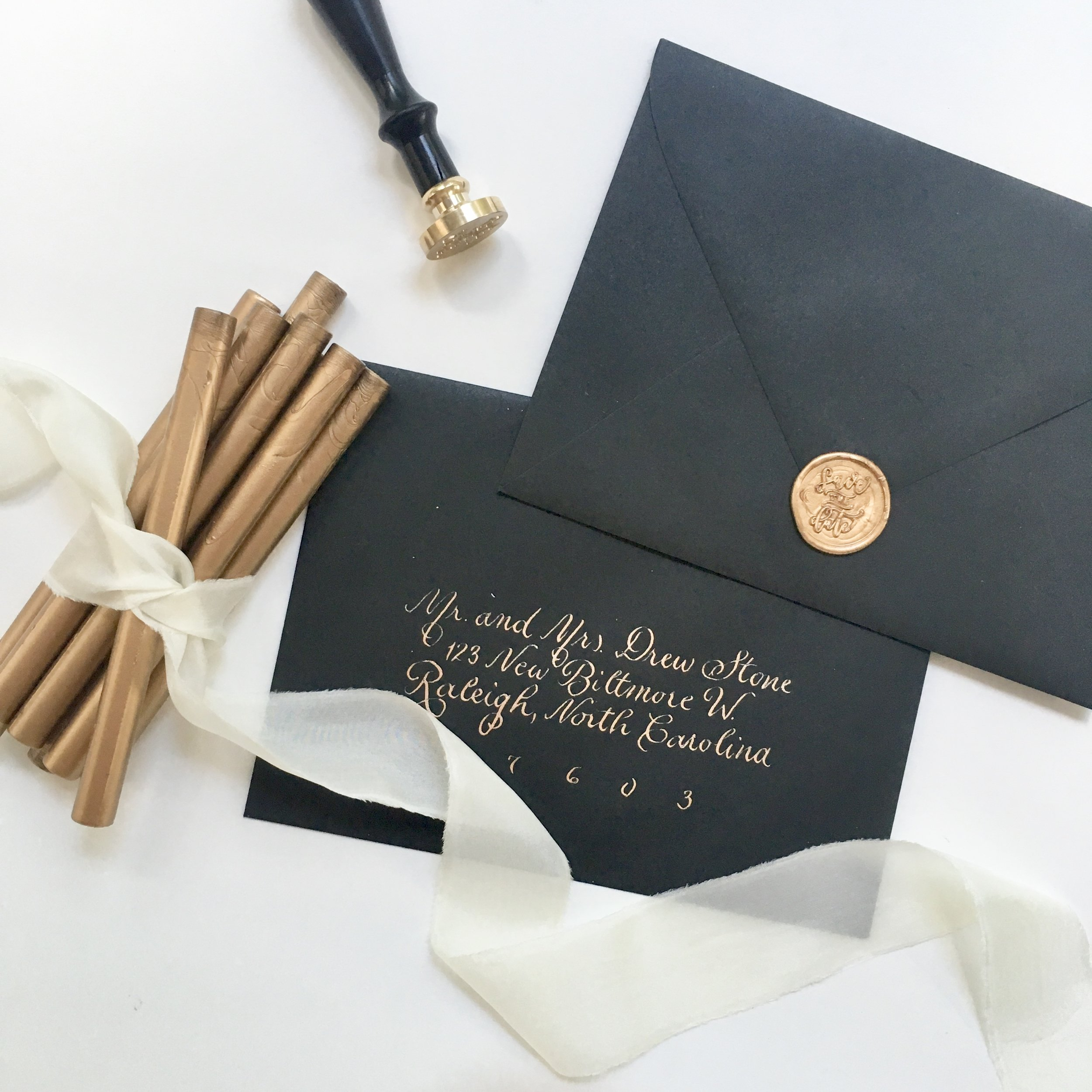 Pictured: Antique Gold Wax Sealing Sticks by Uniqooo and Save the Date Wax Seal Stamp by Uniqooo