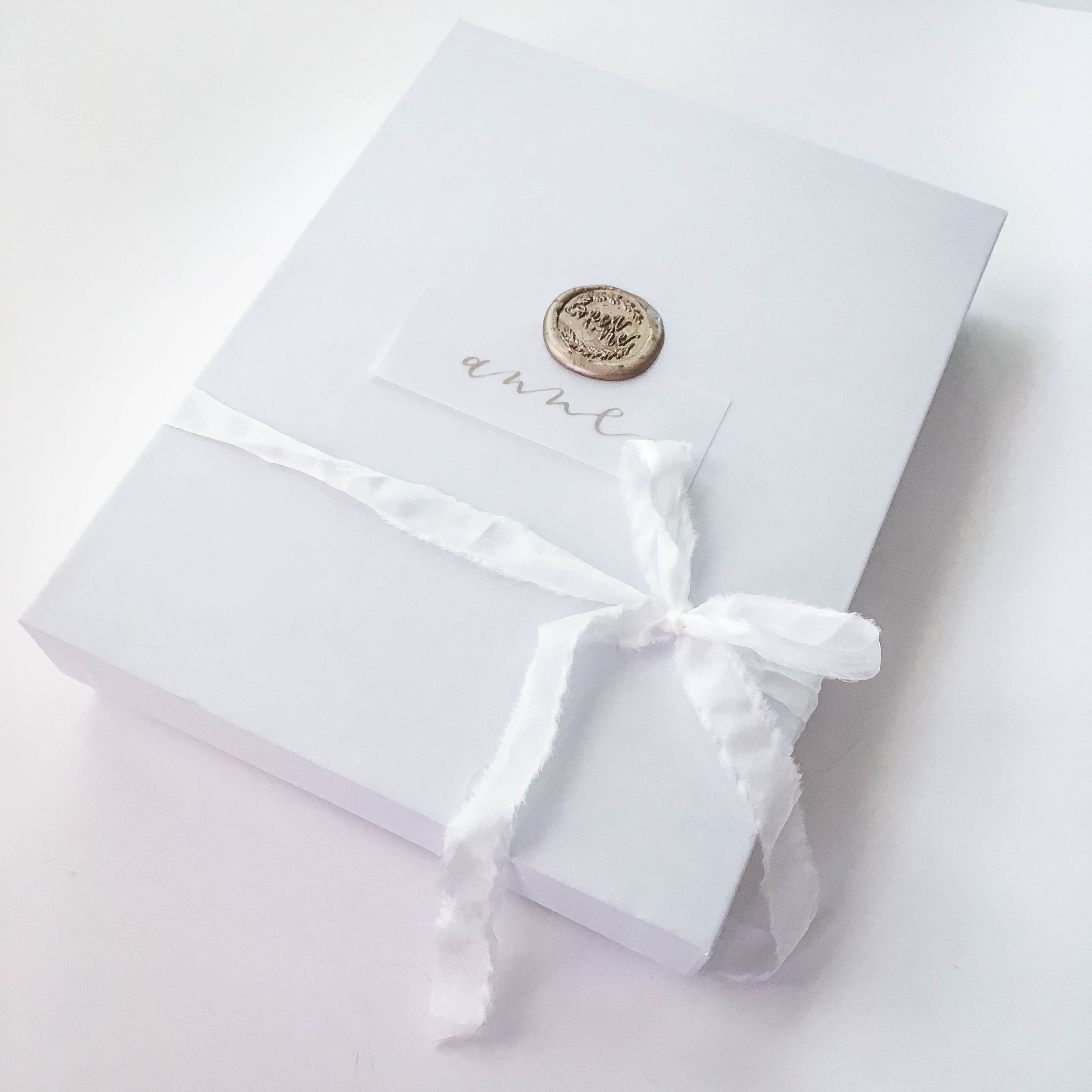 Pictured:  Vellum Place Cards ,  Champagne Gold Wax Beads  and  Open Me Wax Seal Stamp  by Uniqooo