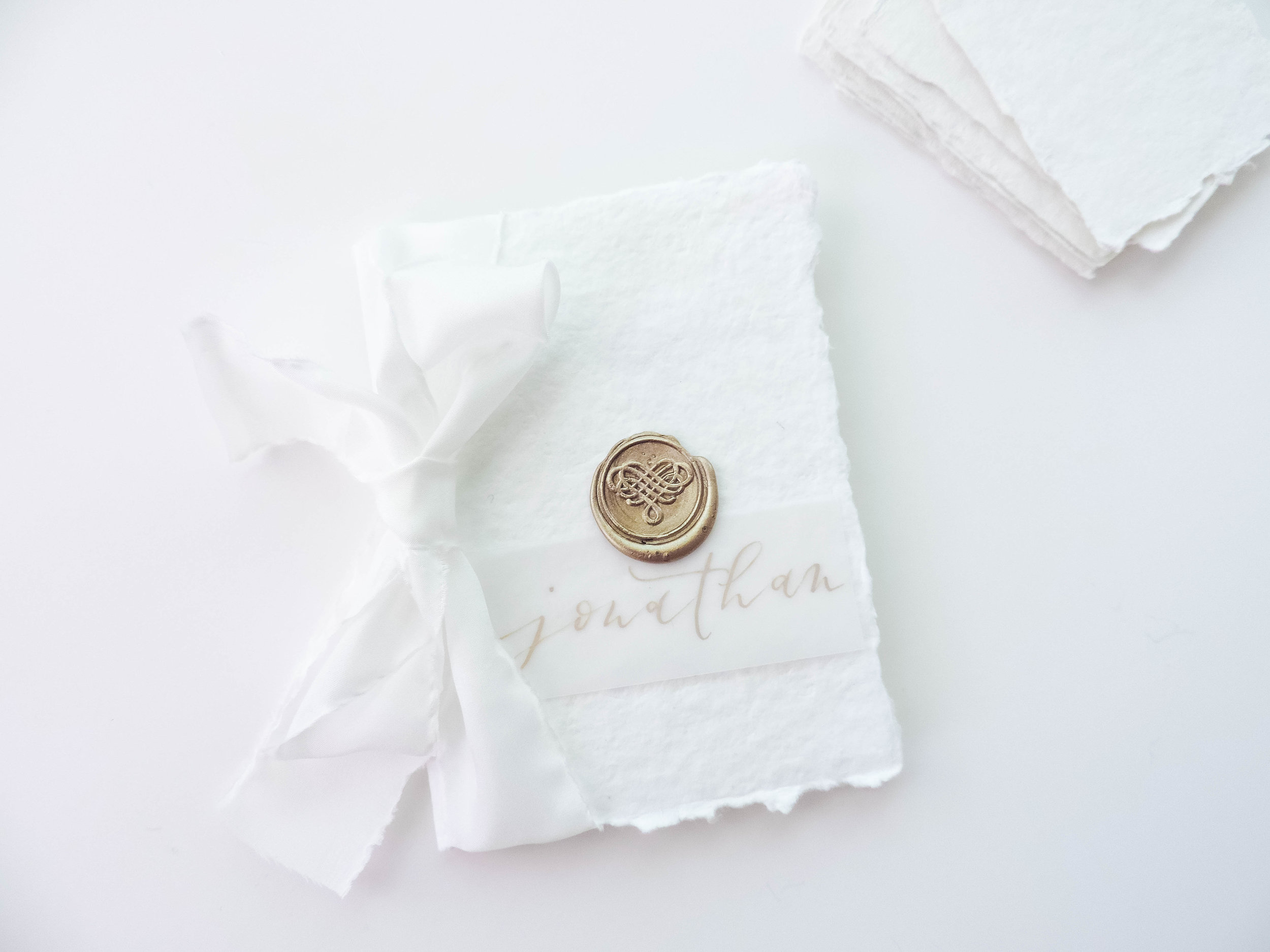 Pictured:  Vellum Place Cards ,  Antique Gold Wax Sticks  and  Heart Wax Seal Stamp  by Uniqooo