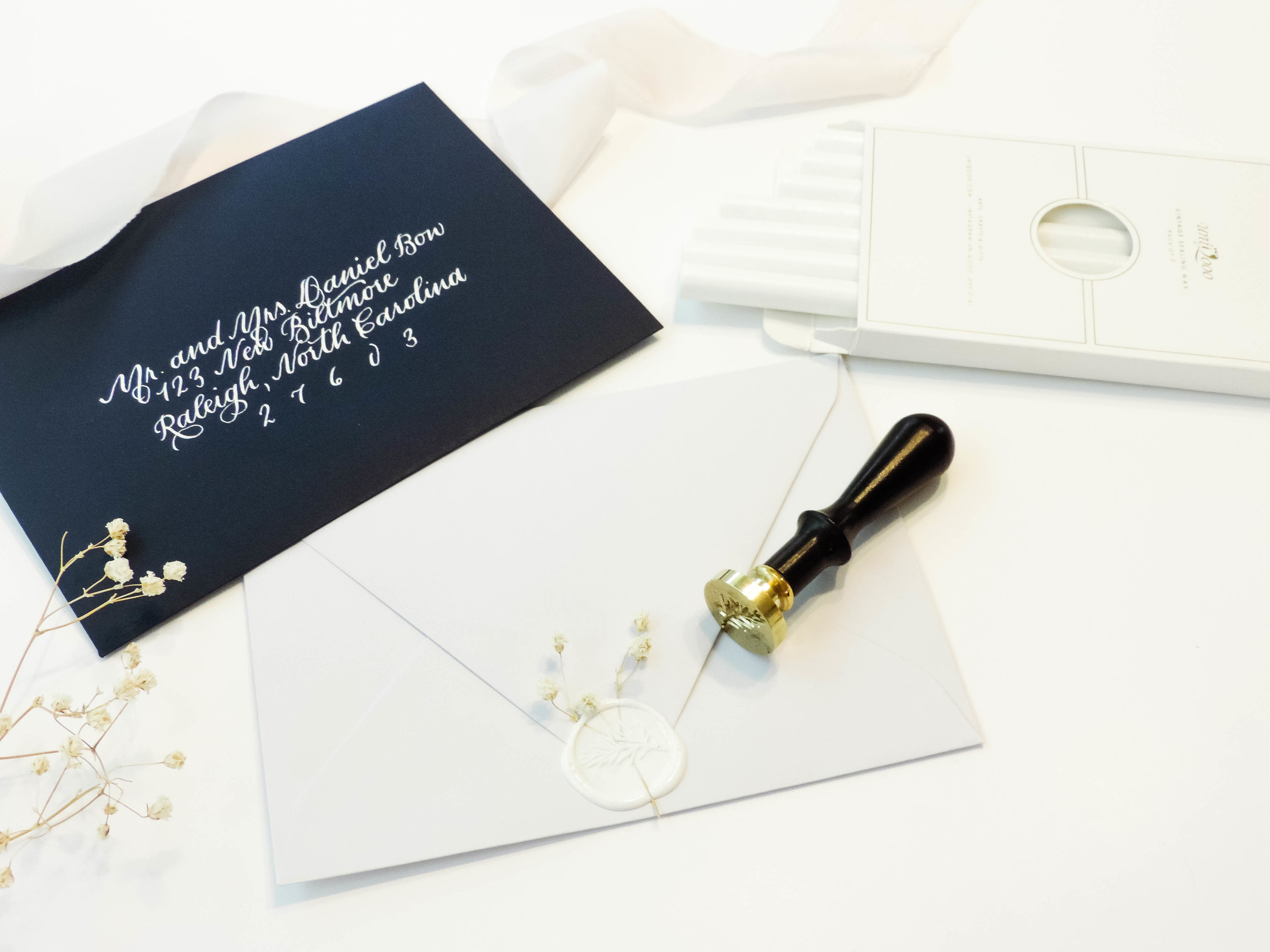 Pictured:  White Wax Sealing Sticks  and Botanical Wax Seal Stamp by Uniqooo