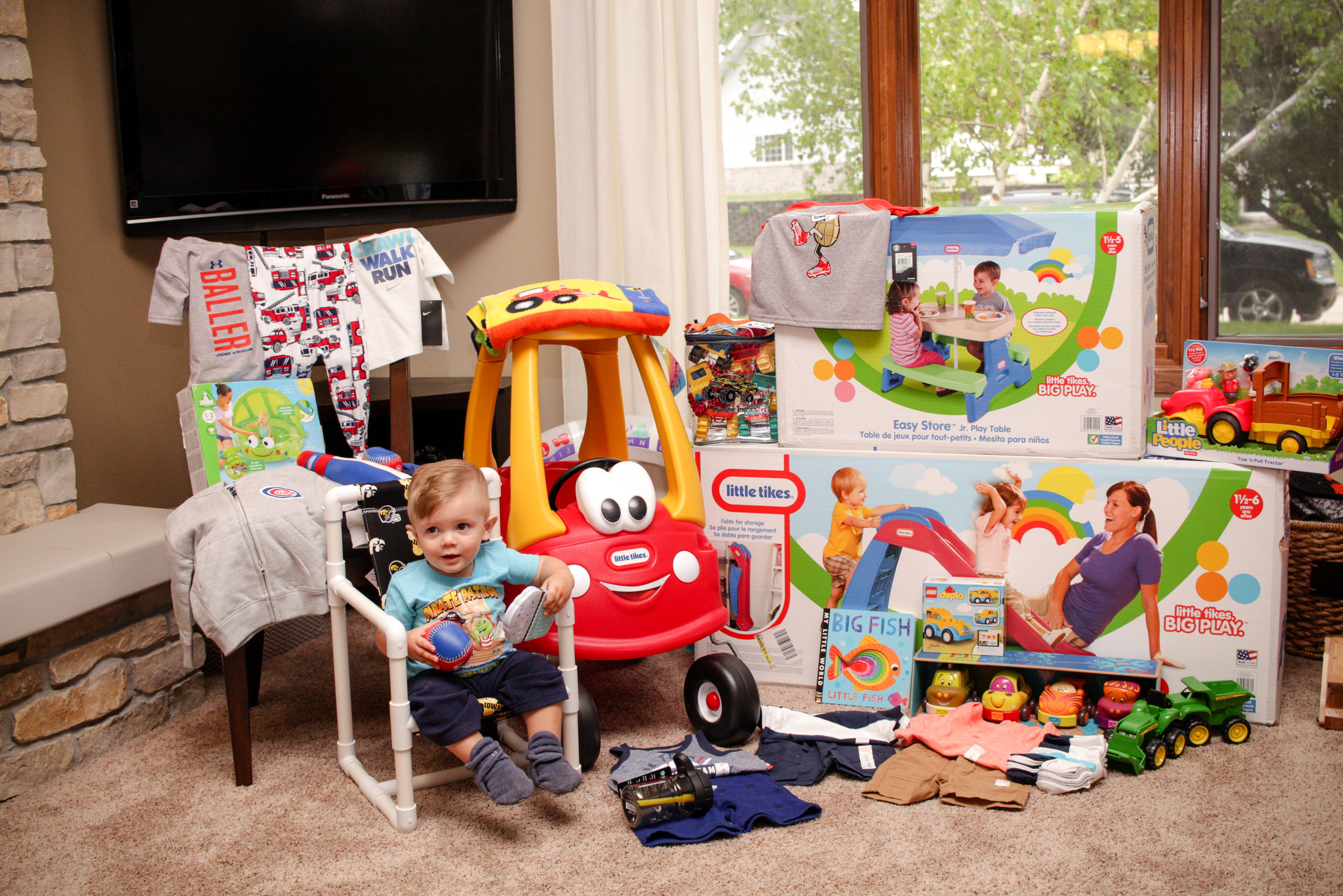 I think it's safe to say he made out pretty well in gifts for his first party! He especially enjoyed sitting in his new chair and scooting around in his red and yellow car.