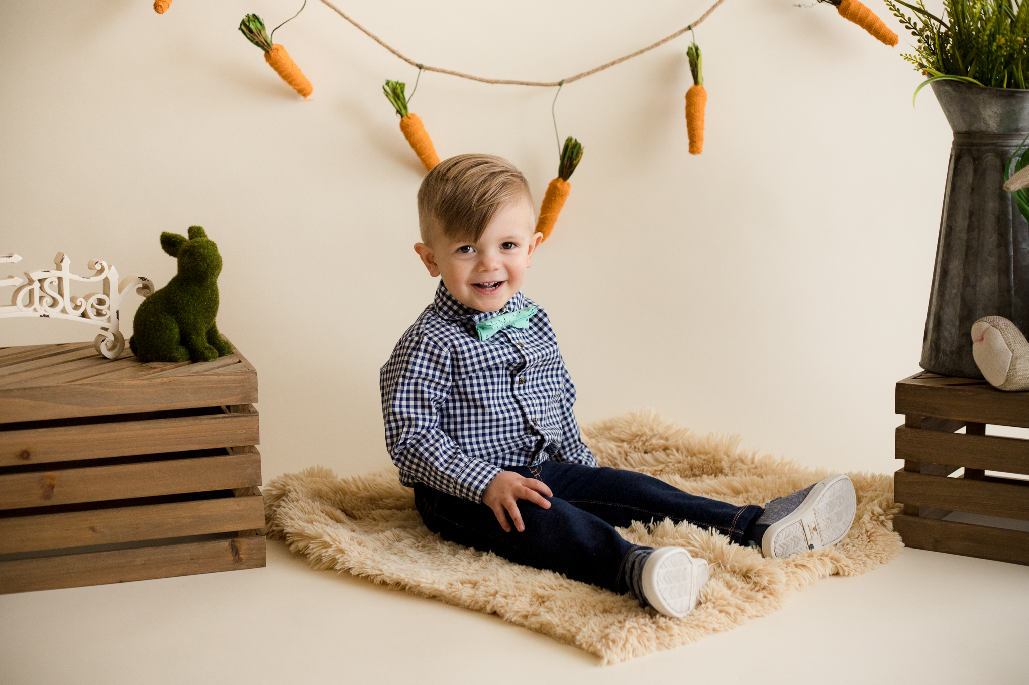 Two year old boy sitting for Easter Mini Session in Cedar Rapids, Iowa.
