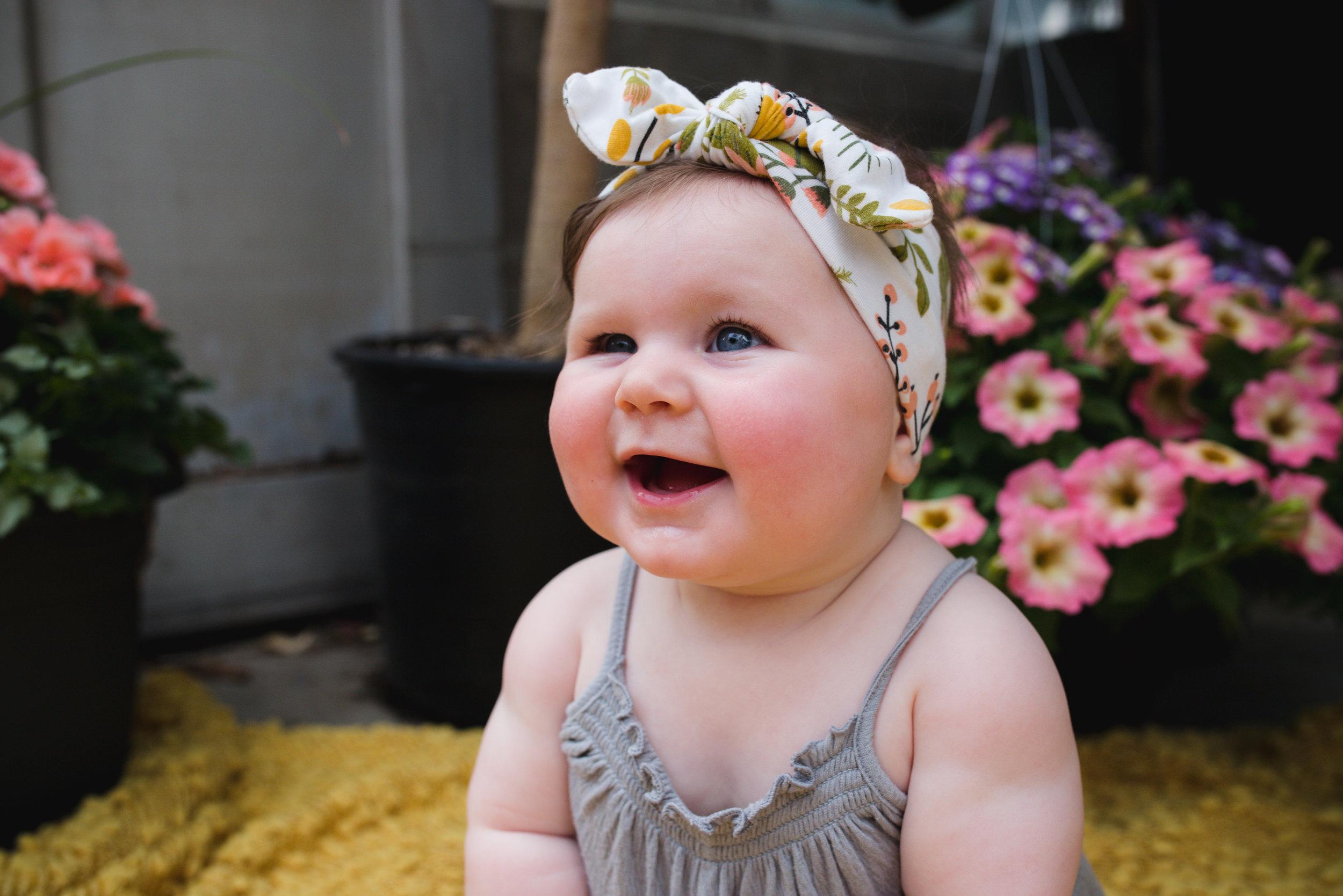 A baby girl smiling in Cedar Rapids, Iowa.