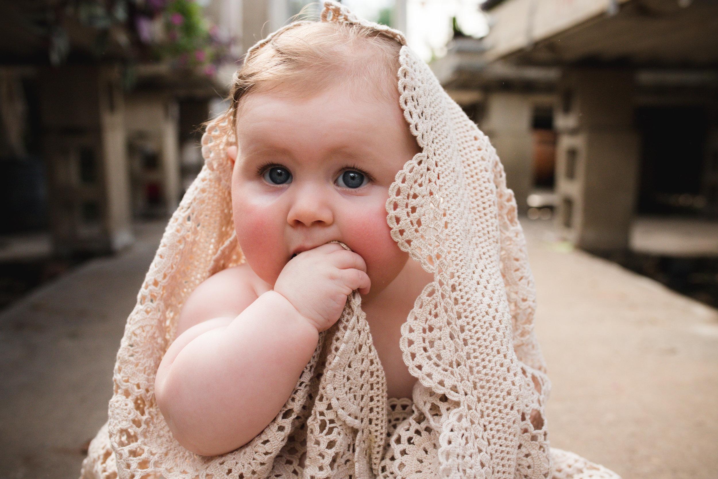 Doily blanket over baby girl in Iowa.