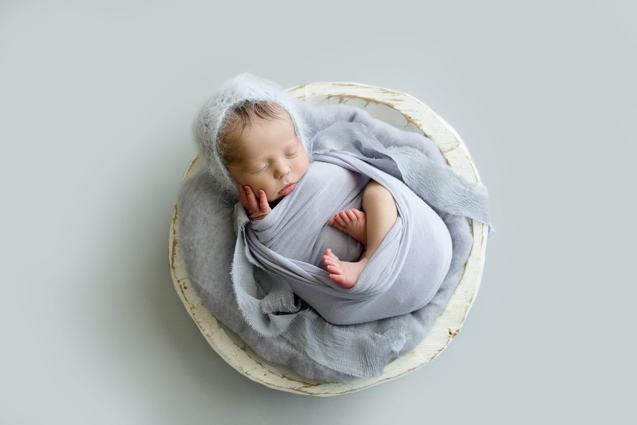 Baby girl in lavender gray in Cedar Rapids.