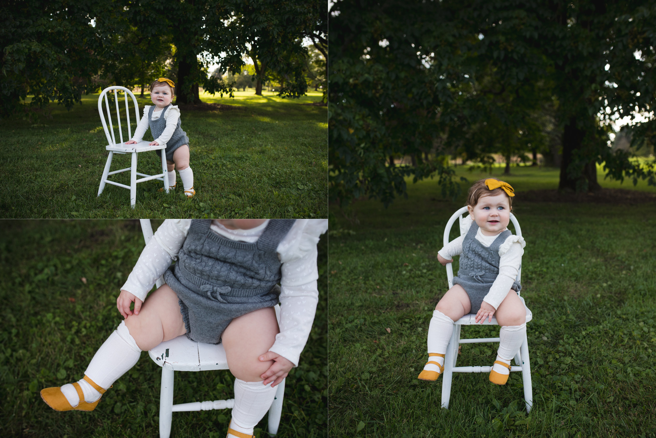 One year old baby girl sitting and standing by a white wooden chair during her one year old photo session at Morgan Creek Arboretum in Palo, Iowa.