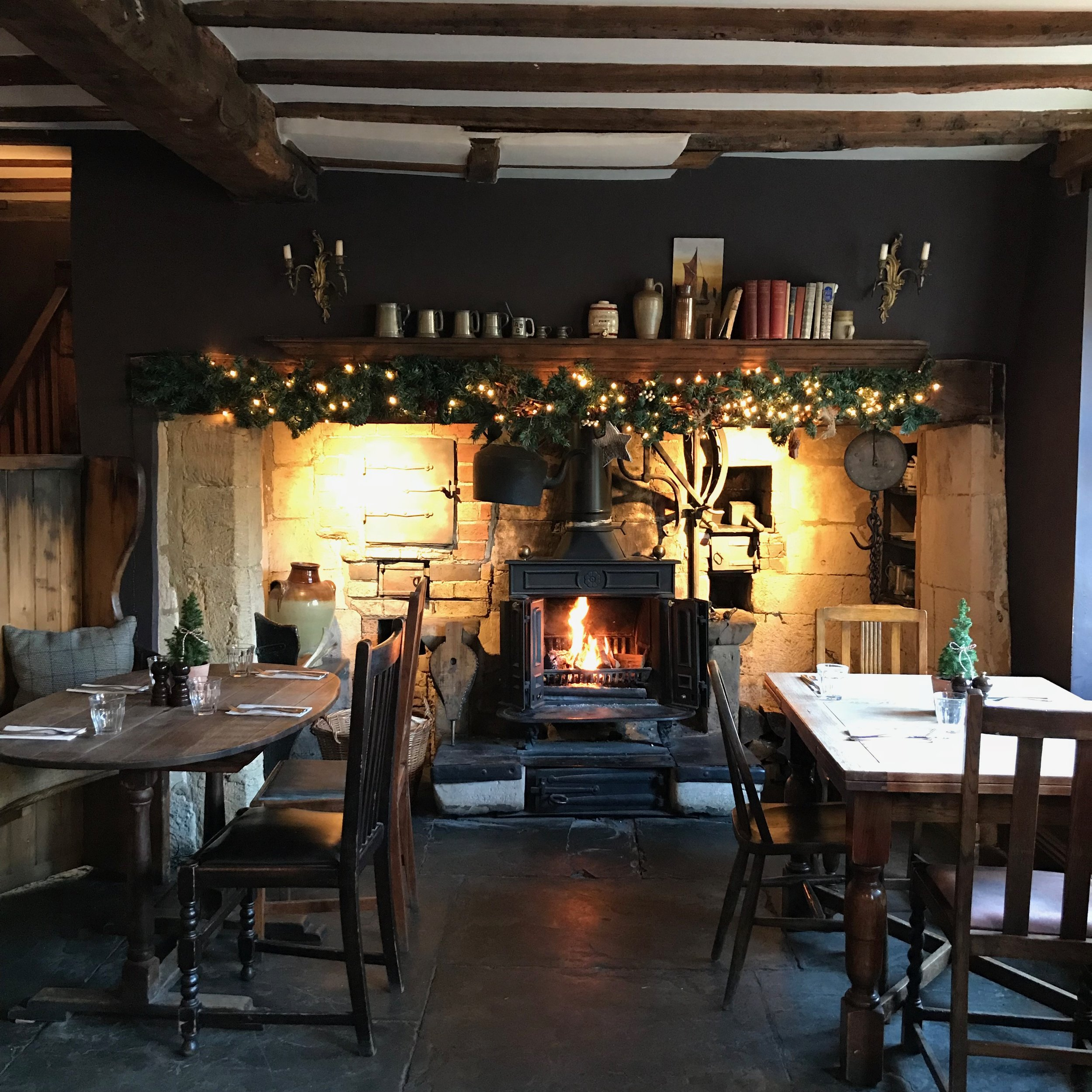 Fireplace in the Bakers dining room at The Ebrington Arms, once of the Cotswolds' finest