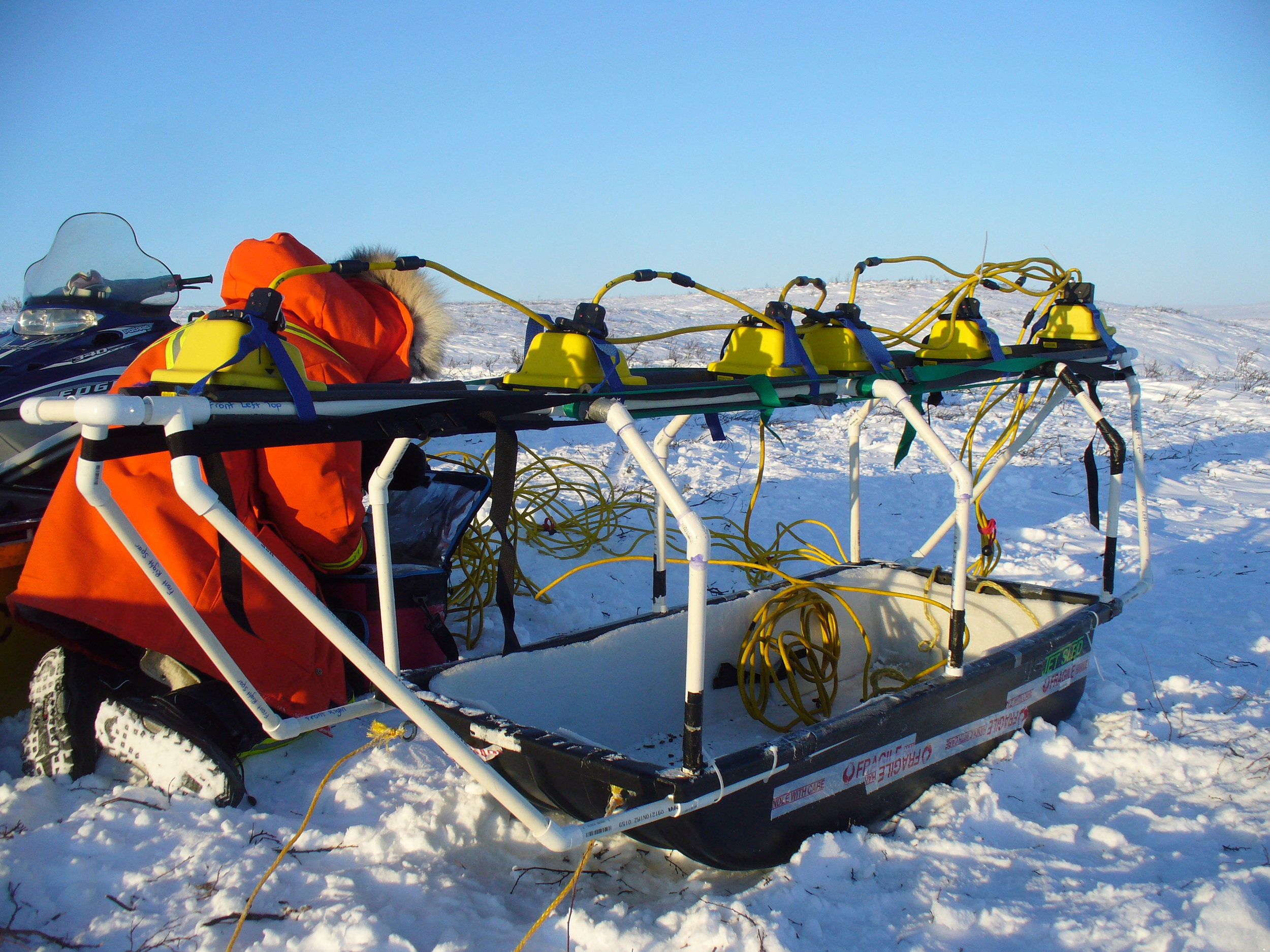 Setting up to collect multi-offset ground-penetrating radar data in Inuvik, Canada, at -40C