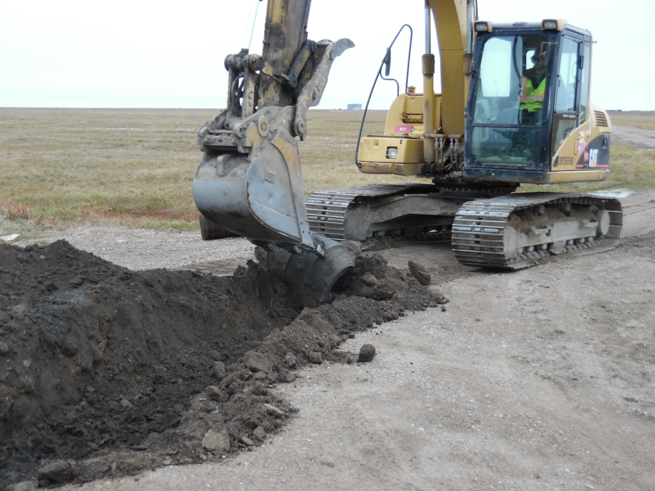 Removing debris, discovered with the EM-61 metal detector, from a landfill in Northern Alaska