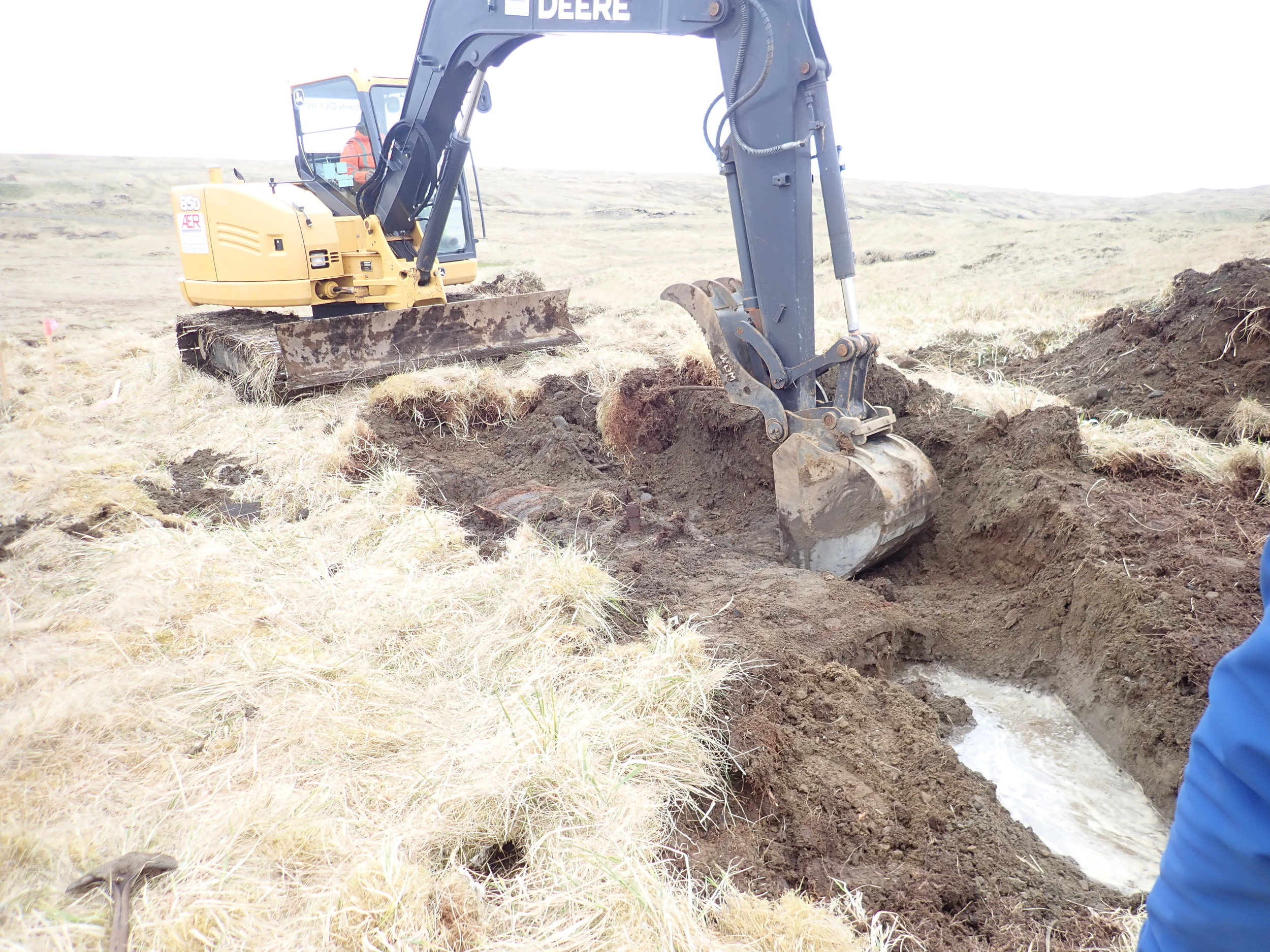 Removing an underground storage tank from a contaminated site