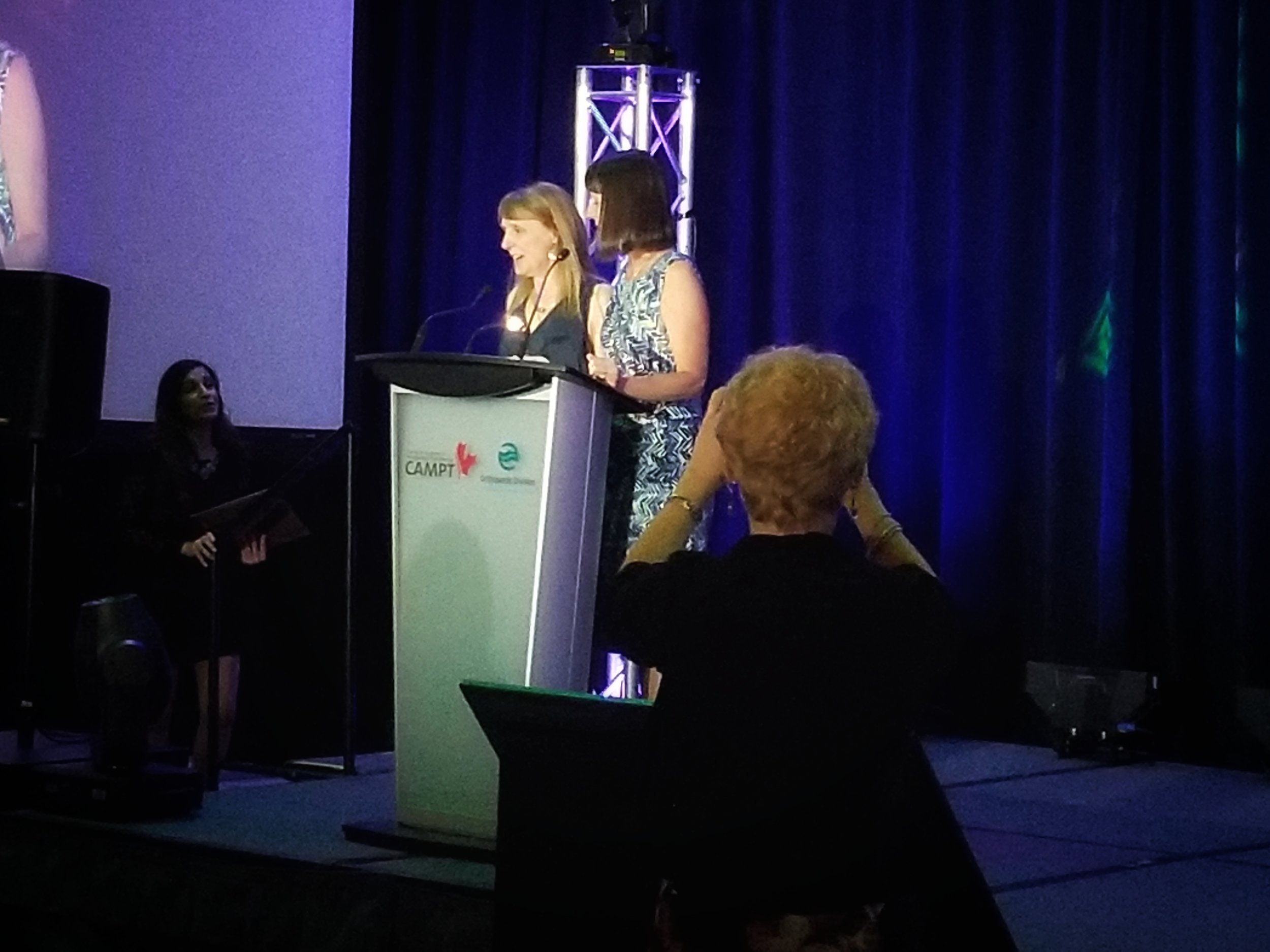 Lenerdene receiving the Golden Hands Award, given for her contributions and excellent in manual therapy in Canada.