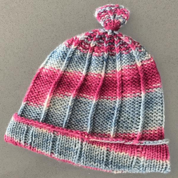 Allison Hat,  a baby hat using one skein of Half & Half Sport in Berry Blue Raspberry