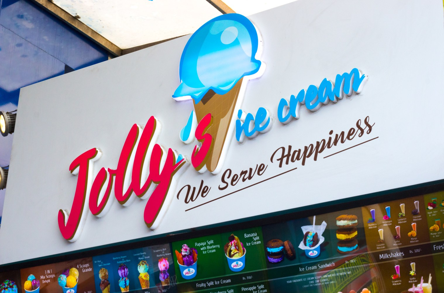 The colourful Jolly's Ice Cream sign sits over the small shipping container storefront in Colombo, Sri Lanka.