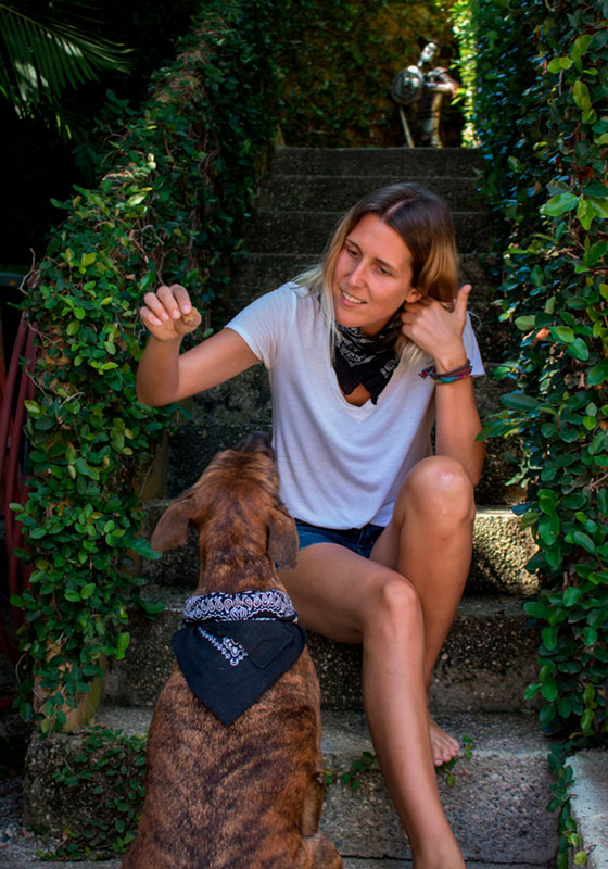 Anne and Paco pose for a photo in matching bandanas at home in Mexico - Go Squab