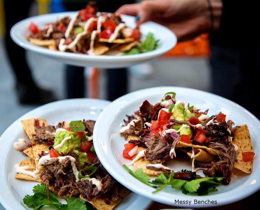 Smokey Q Fierce Bull Spiced Beef with Guacamole and Spicy Sour Cream on Tortilla Strips