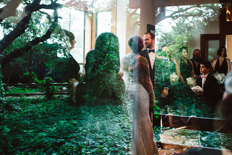 With the weather requiring us to move the ceremony indoors, I love this shot reflecting the gardens just on the other side of the window.