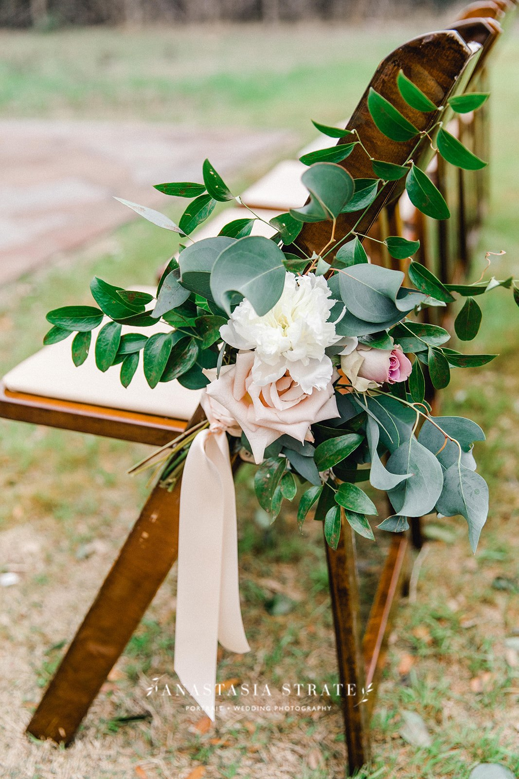 outdoor ceremony chair floral decor