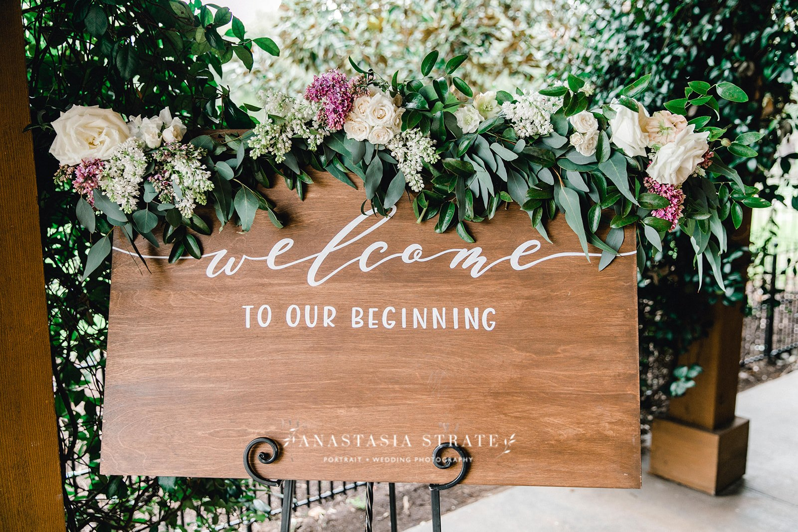 wooden welcome sign with greenery decor