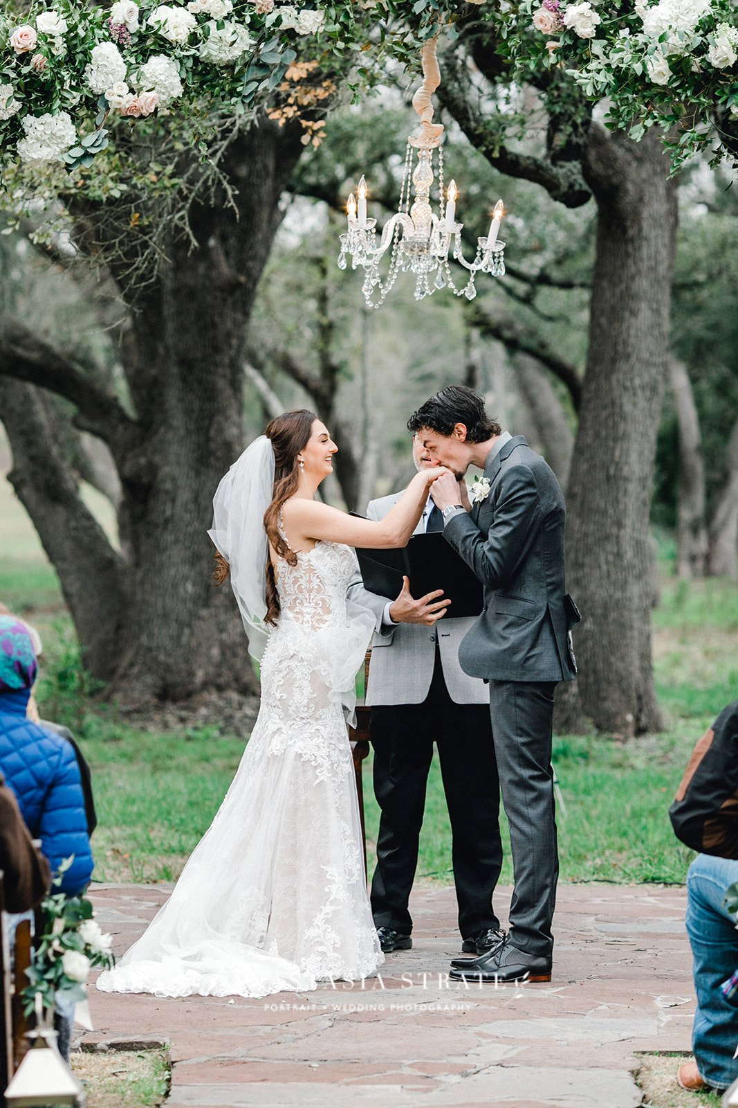 bride and groom during their greenery Austin wedding