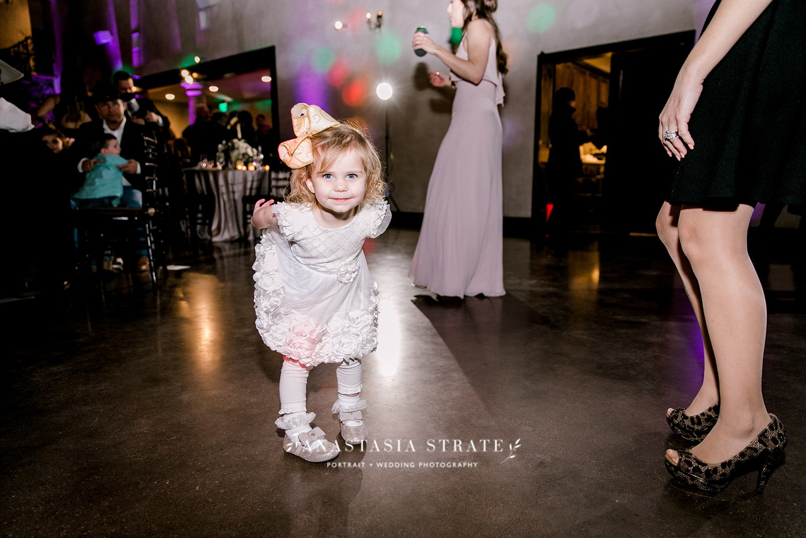little girl dancing at the wedding reception