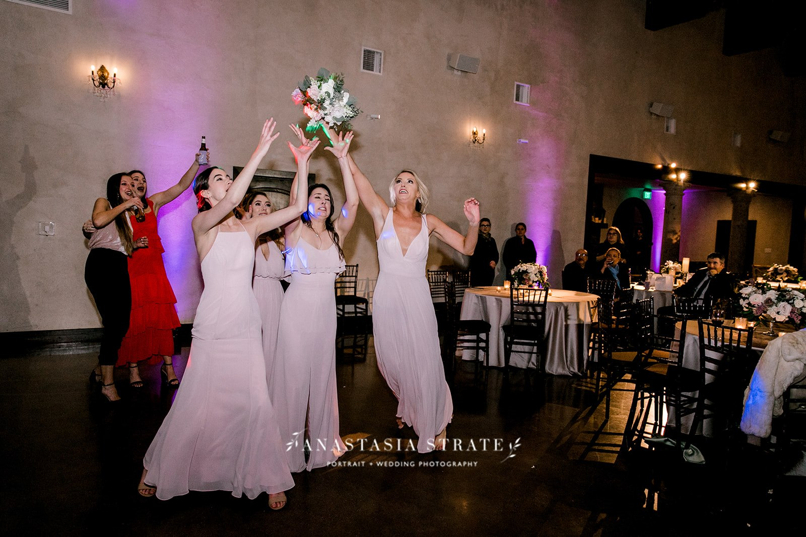 bridesmaids catching the bouquet