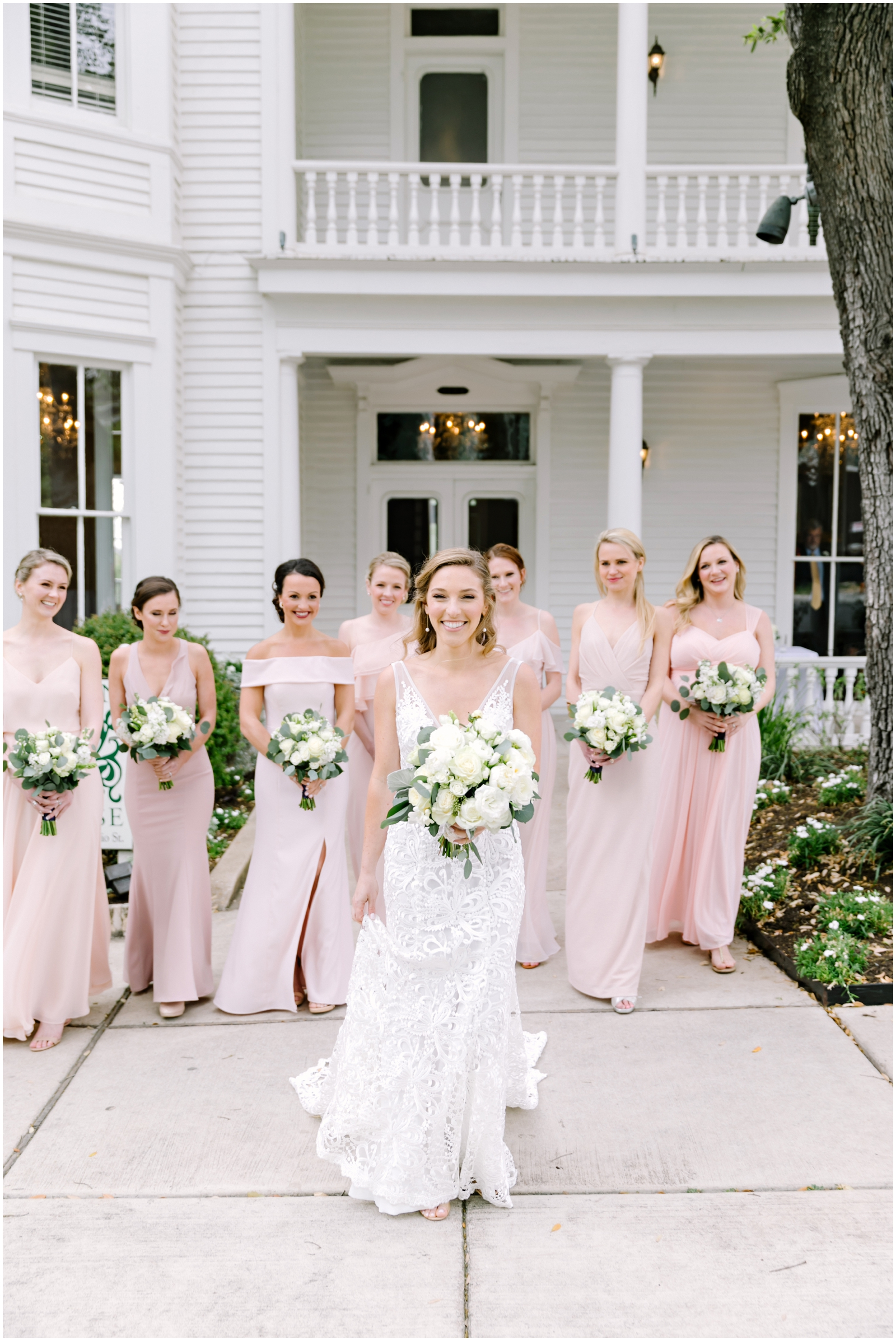 bride with her bridesmaids before her Texas wedding