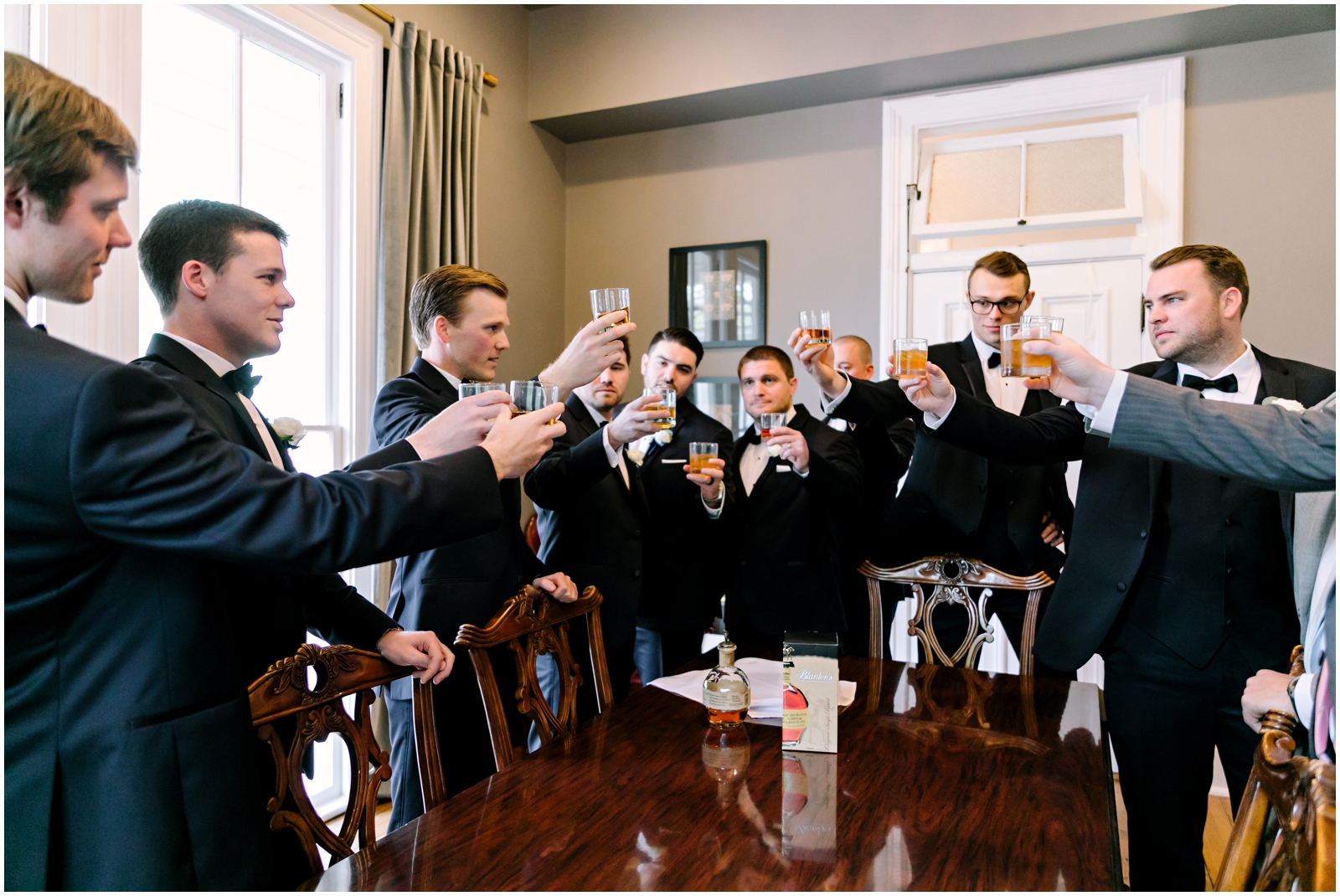 Groomsmen and groom making a toast before the wedding