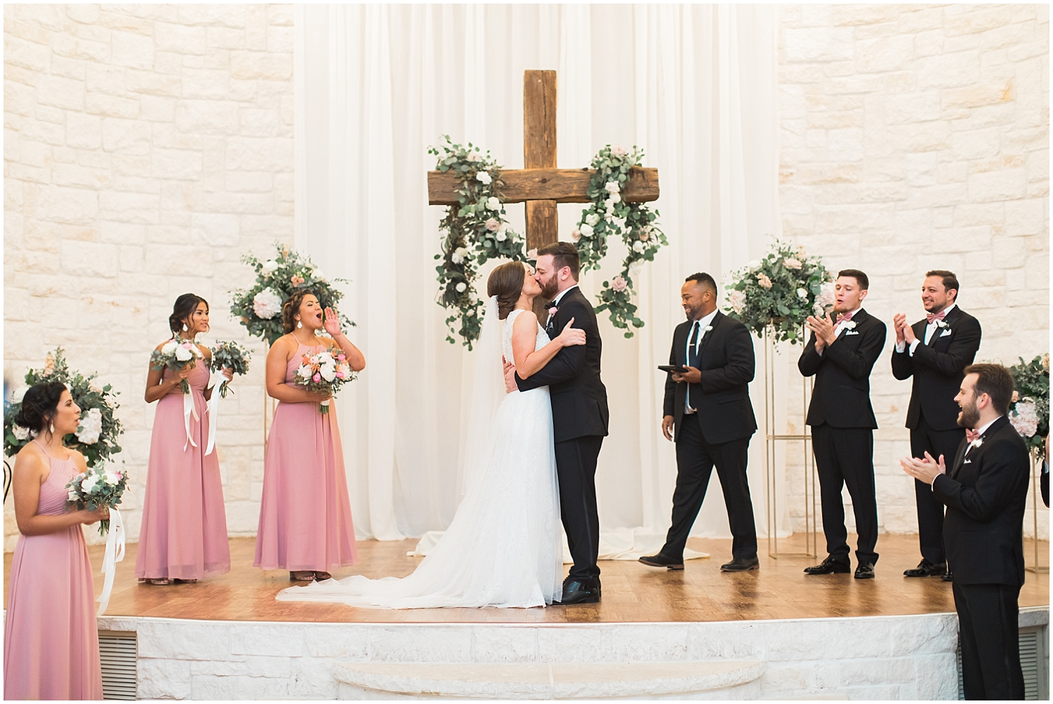 Bride and groom kiss at their Houston wedding ceremony