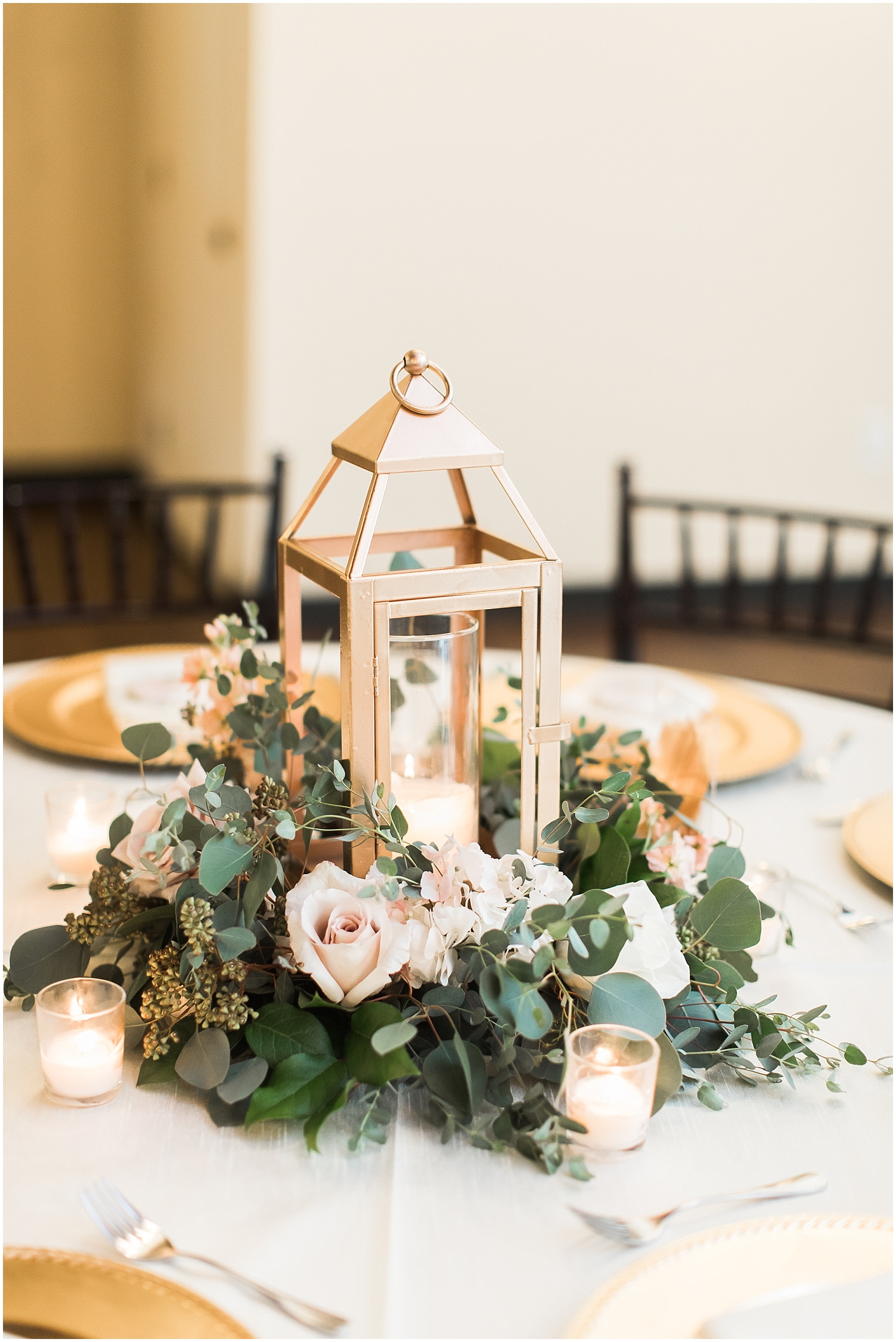 Lantern and floral wedding centerpiece