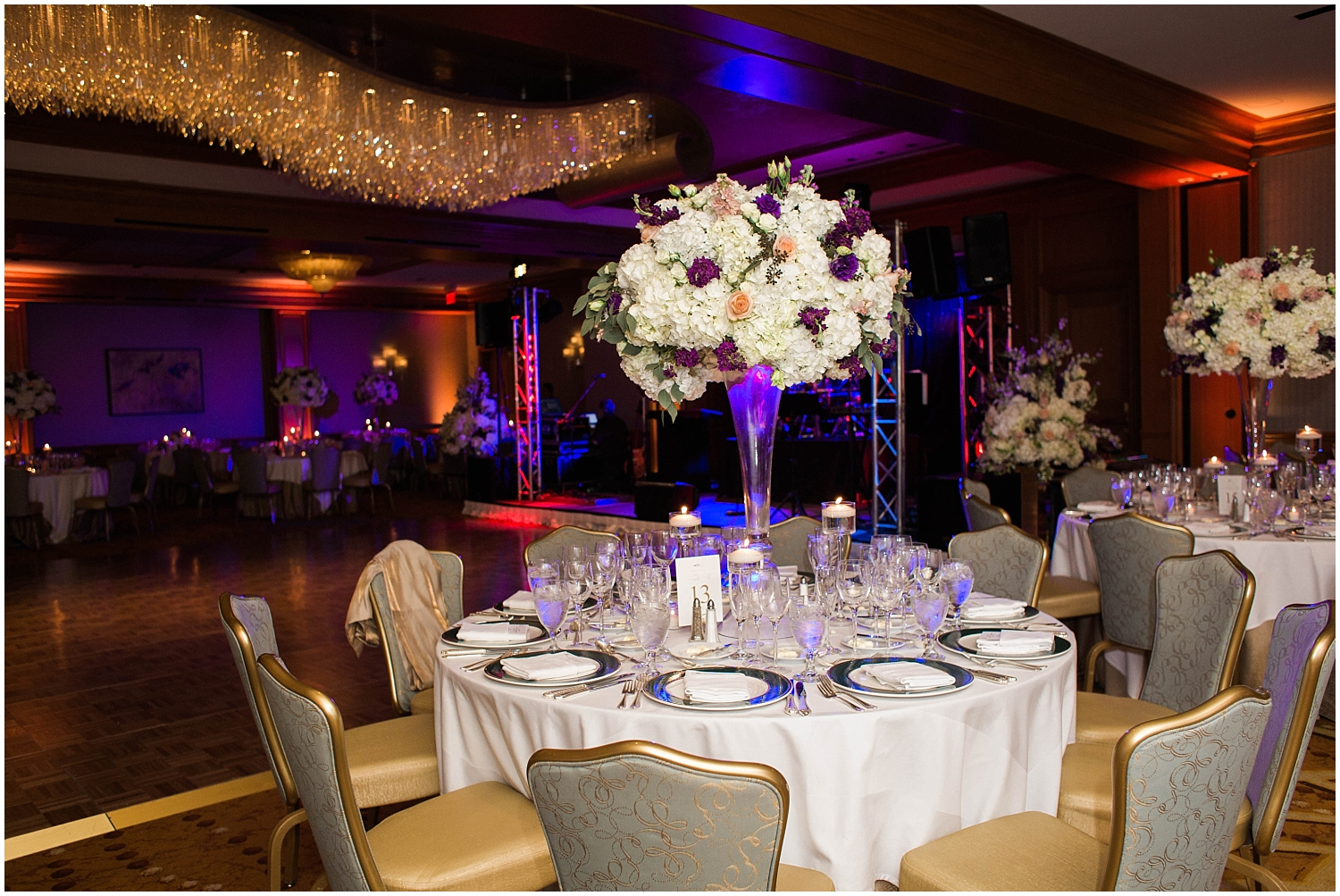 tall wedding centerpiece with purple and white flowers