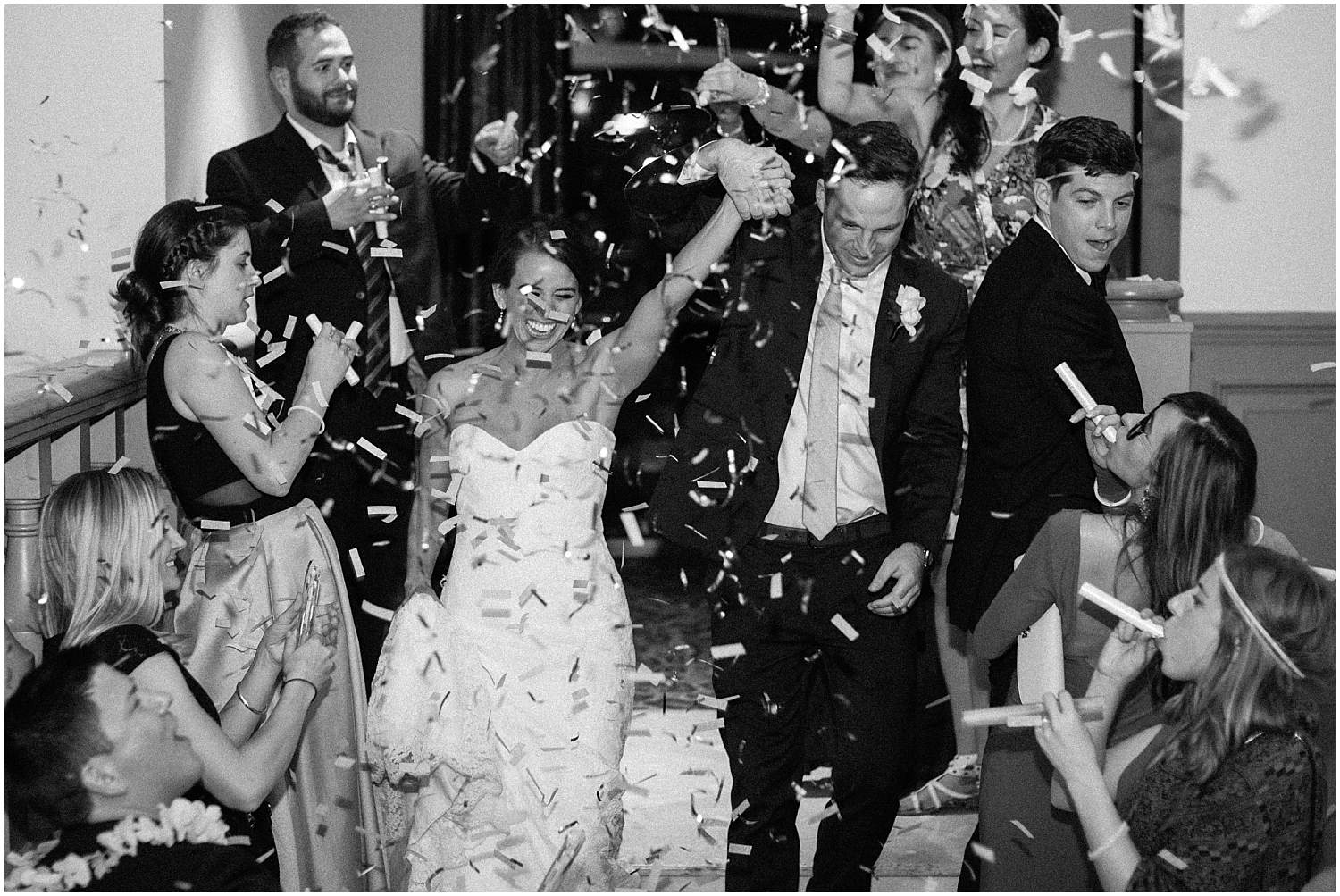 the bride and groom's grand entrance with confetti thrown