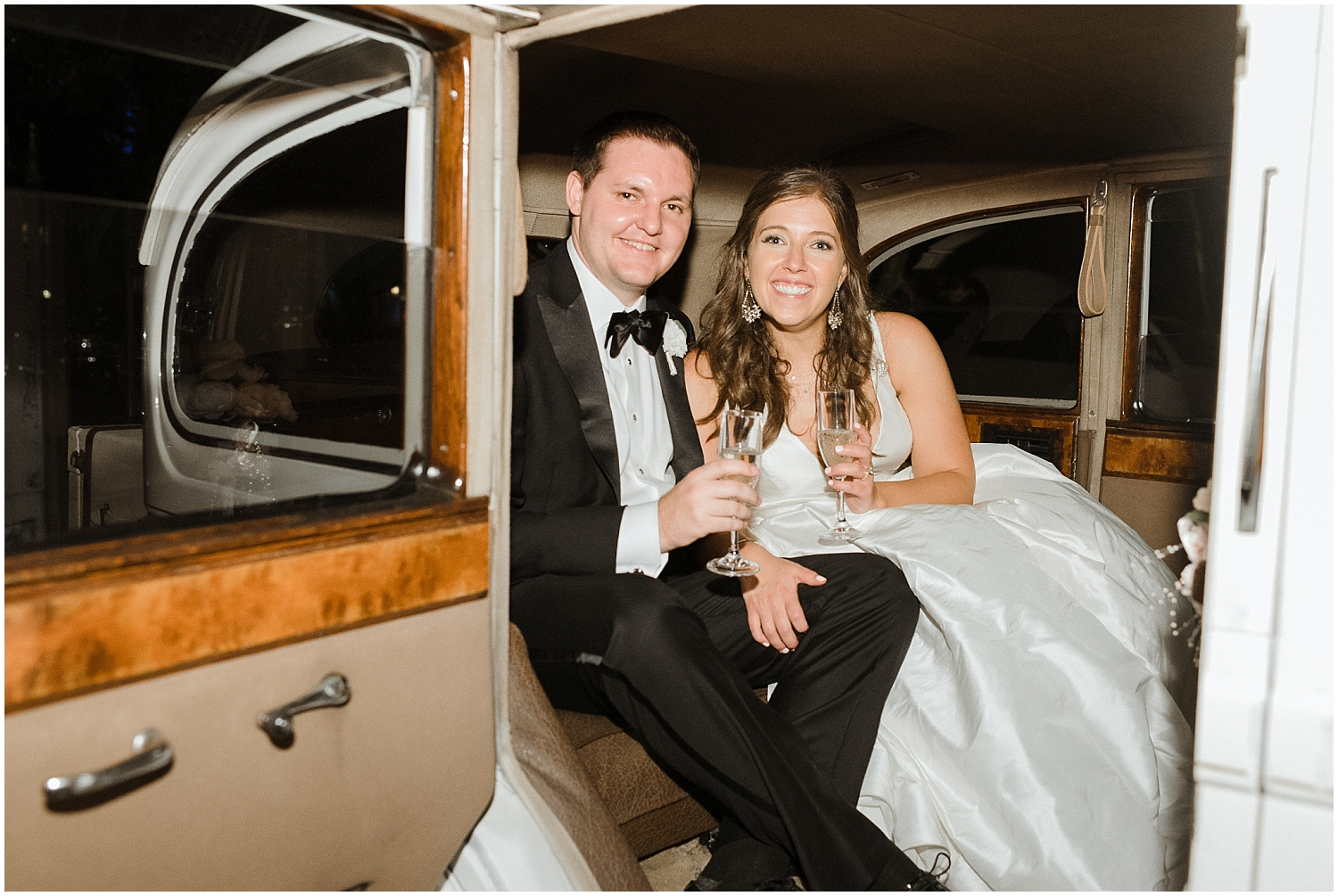 bride and groom leave in a vintage car