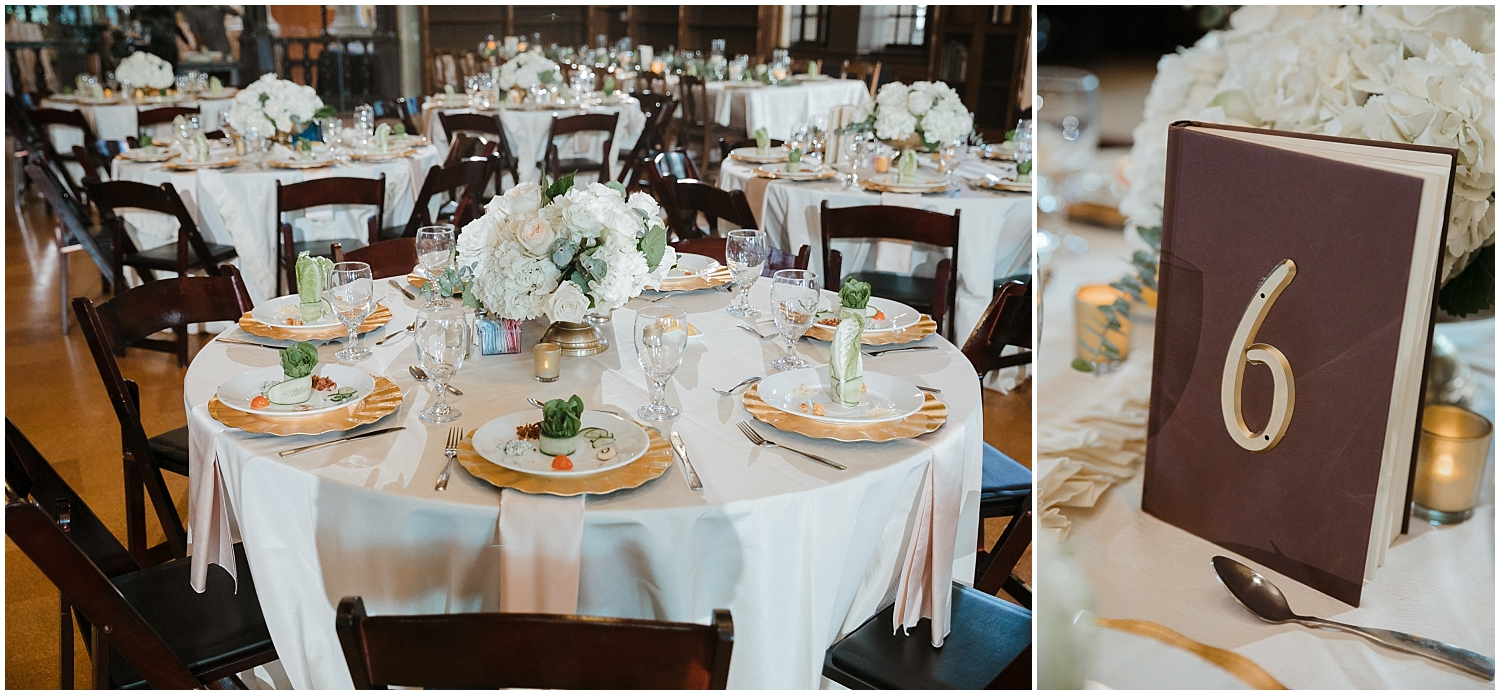 wedding table setting with gold chargers and books used for table numbers