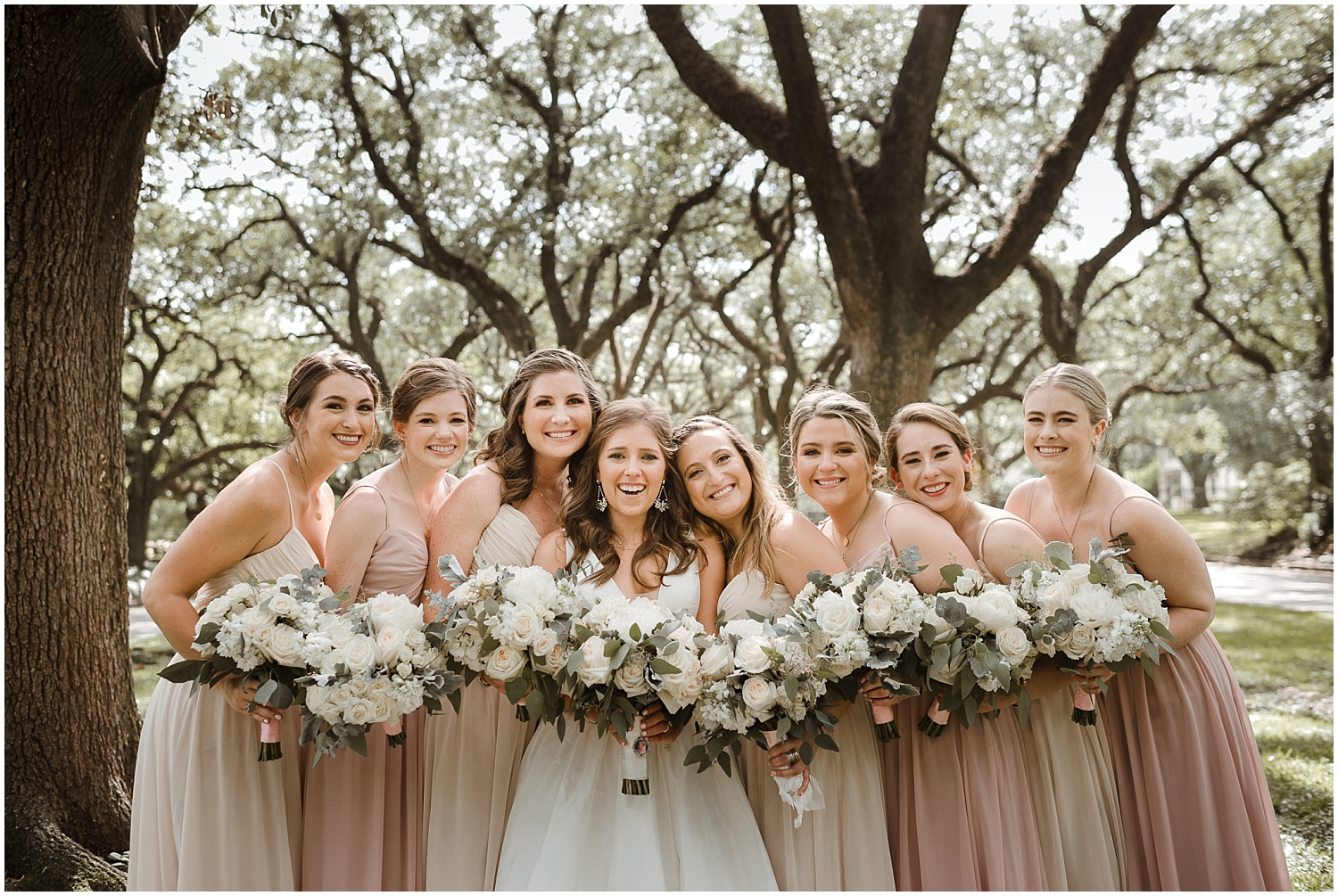 bride and the bridesmaids holding their wedding bouquets