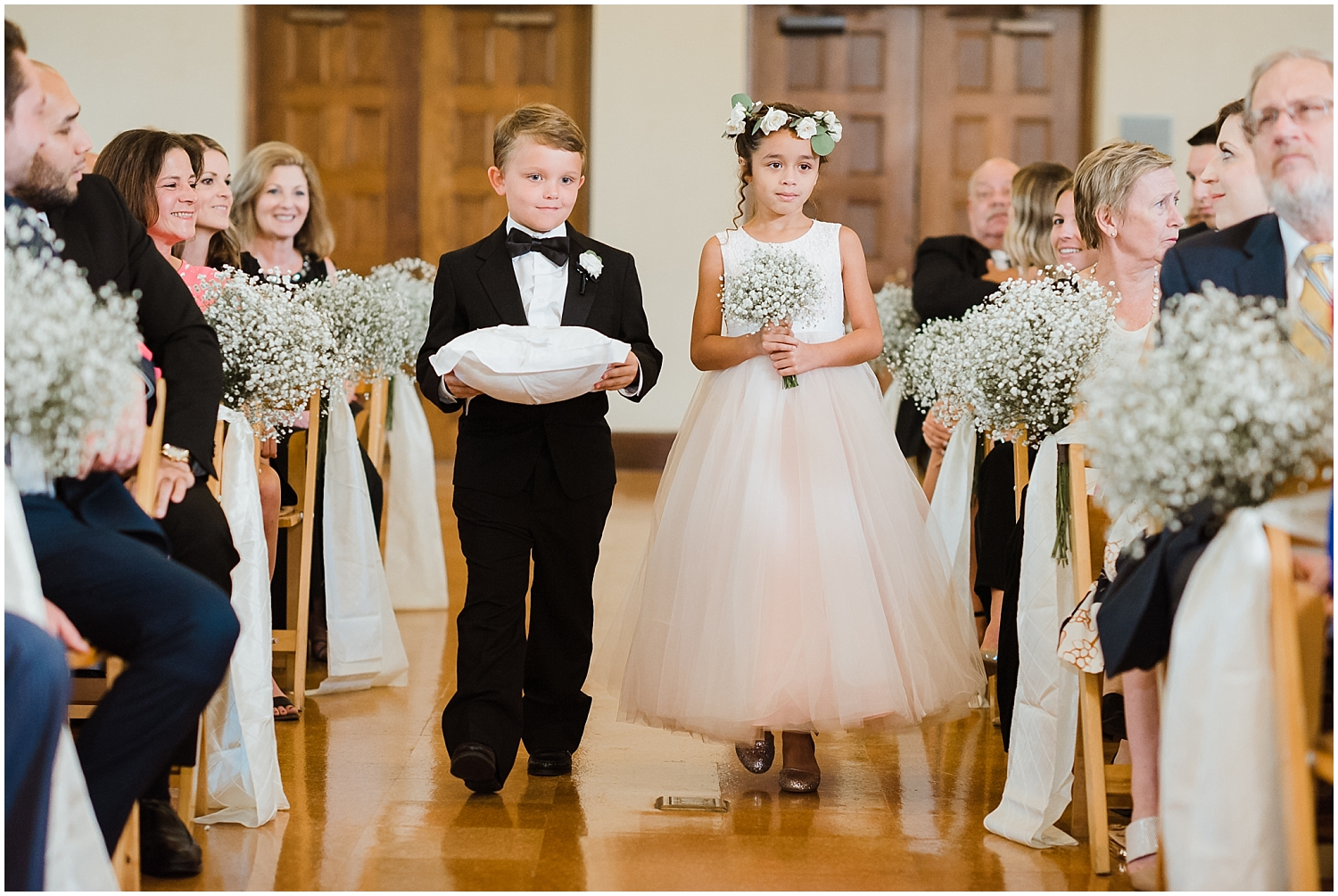 flower girl and ring bearer walk down the aisle