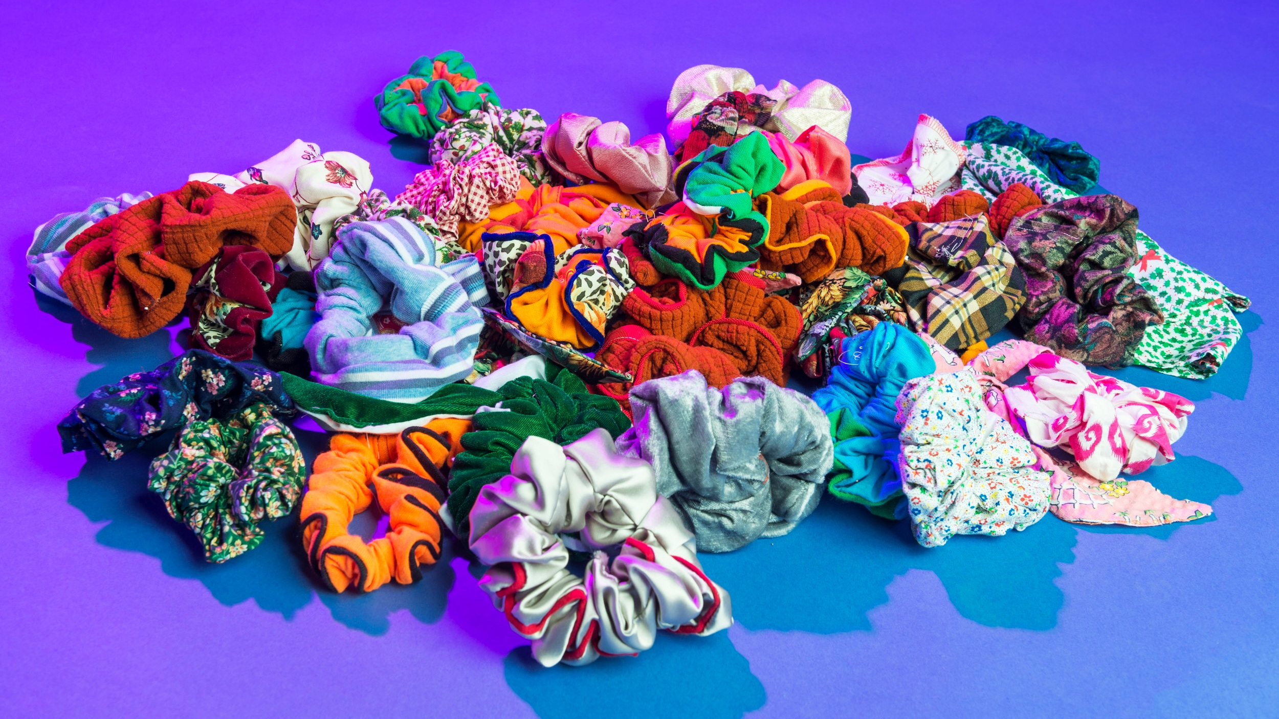 All our fabric is upcycled. Every piece is unique. - We designed our scrunchies to be good for your hair, your community and your environment.