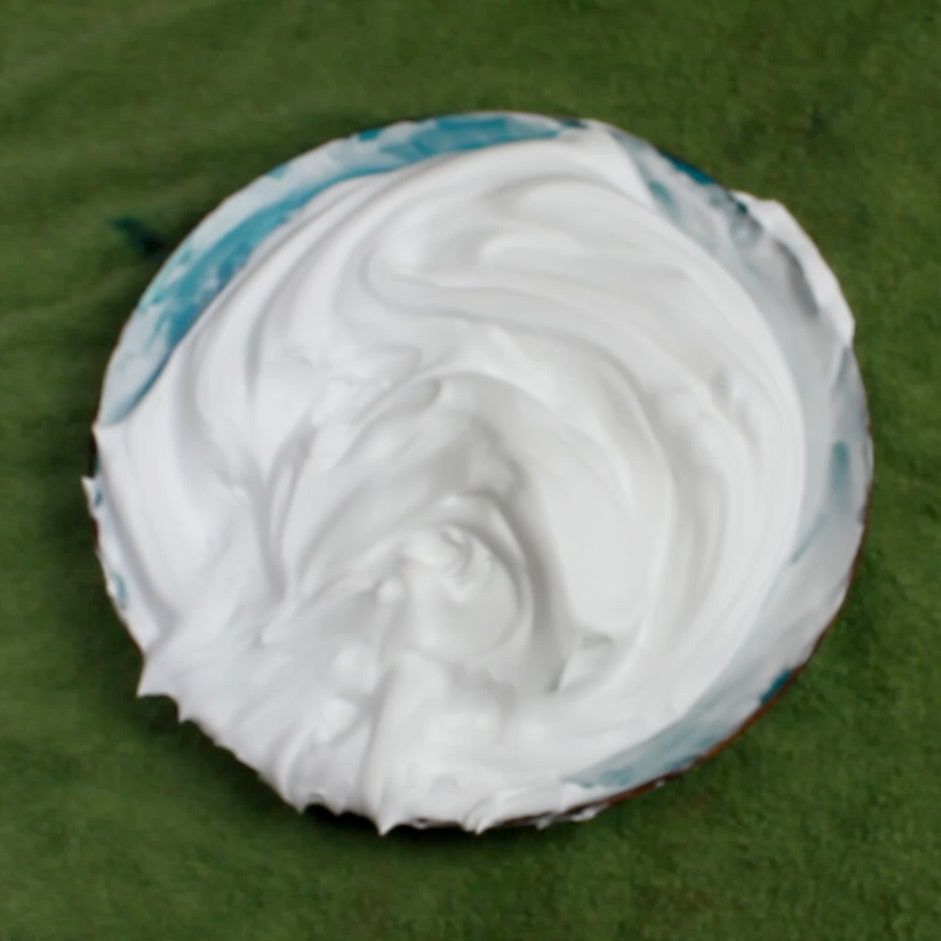 Mix shaving cream and water until it has an even consitency