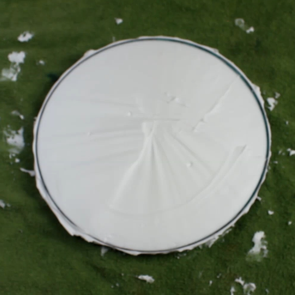 This is what your finished shaving cream bed should look like. It is very important that you get as many of the air bubble out of the shaving cream before dying because it will leave spots on your disc where there is no dye.