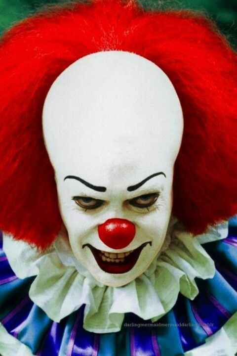 Tim Curry as Pennywise in IT, 1990.