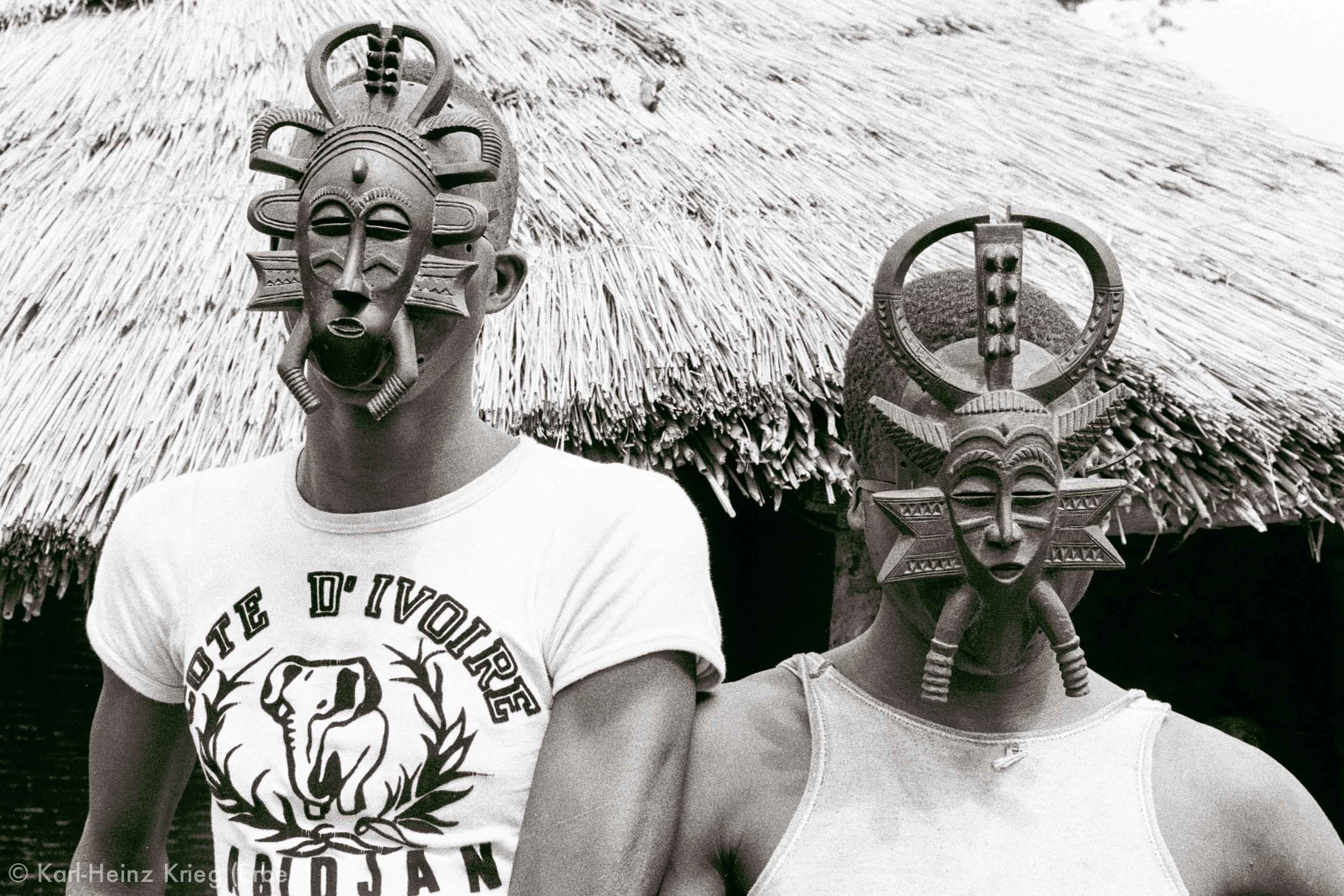 Two  kodaliyèhè  masks carved by Sécondjéwin Dagnogo. Old mask (left) carved in about 1965 and used by the Fono group of Poundiou. New mask (right) carved as an replacement for the old mask in 1977. Poundiou (Region of Boundiali, Côte d'Ivoire), 1977. Photo: Karl-Heinz Krieg
