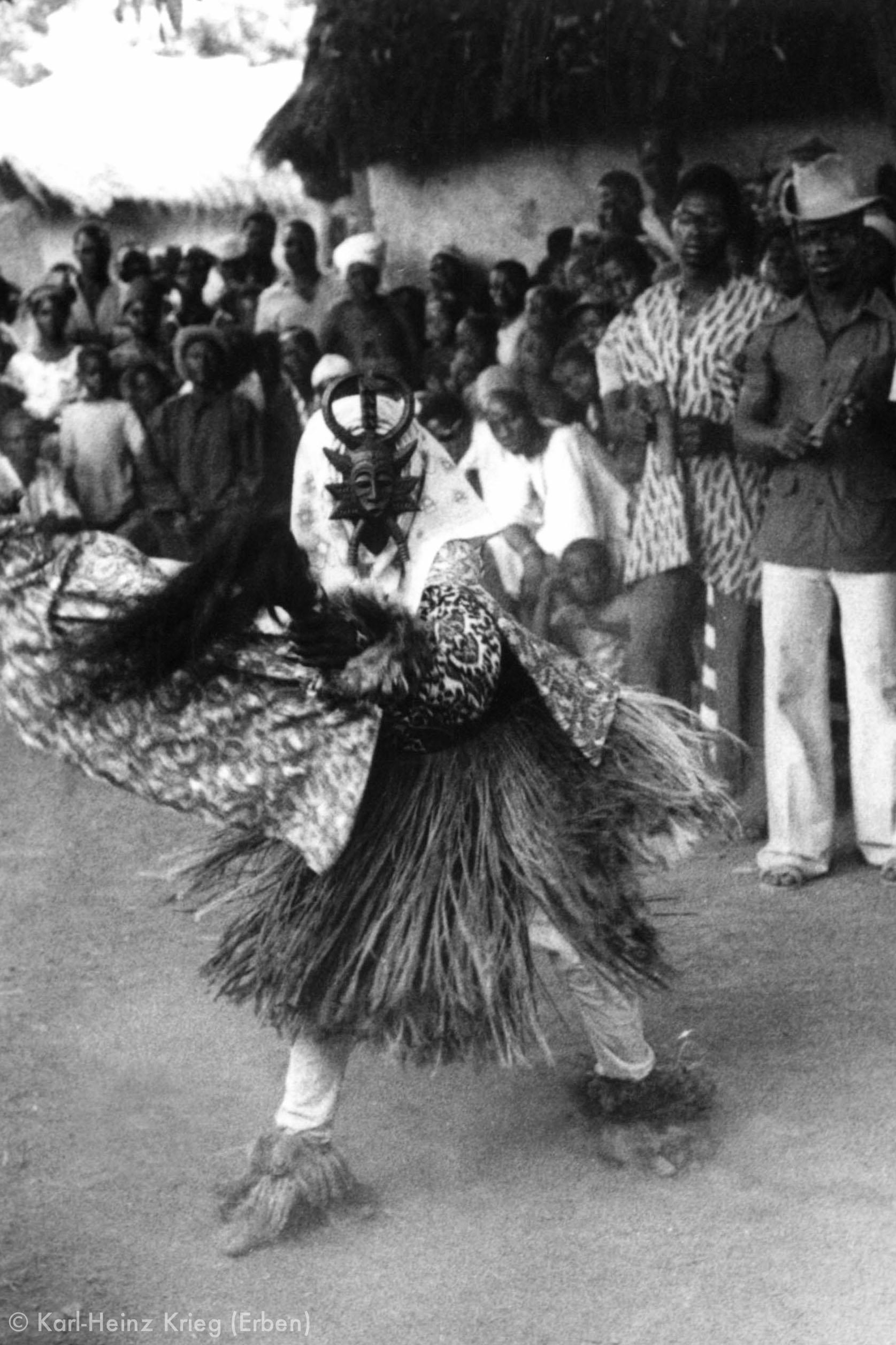 A masked dancer at a funeral of a female blacksmith elder in Poundiou (Region of Boundiali, Côte d'Ivoire), 1978.The mask was carved in 1977 by Sécondjéwin Dagnogo.Photo: Karl-Heinz Krieg