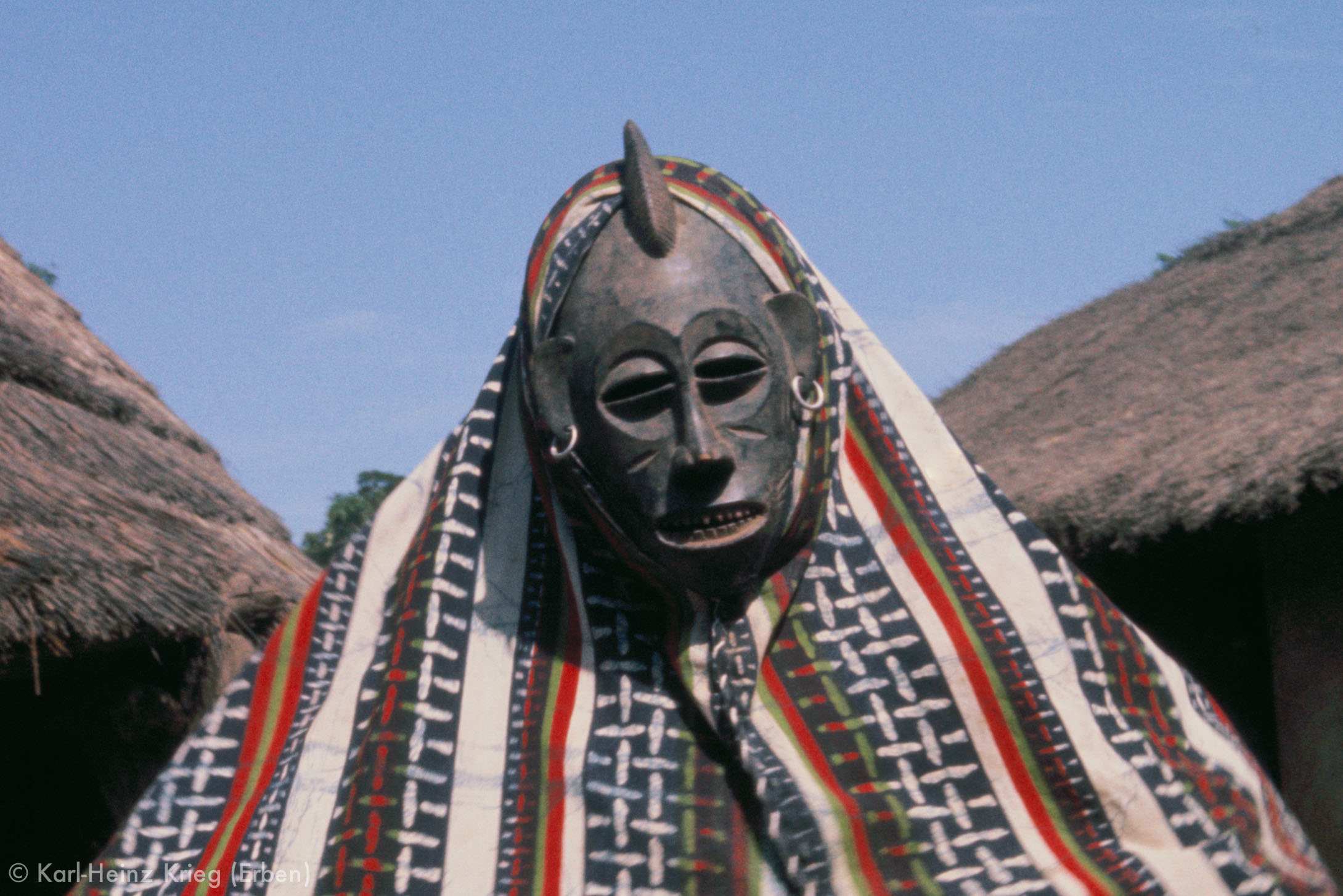 Mask known as  tchèdjouhougué  and was carved by Sécondjéwin Dagnogo about 1968. Documented performing in Poundiou (Region of Boundiali, Côte d'Ivoire),1976.Photo: Karl-Heinz Krieg