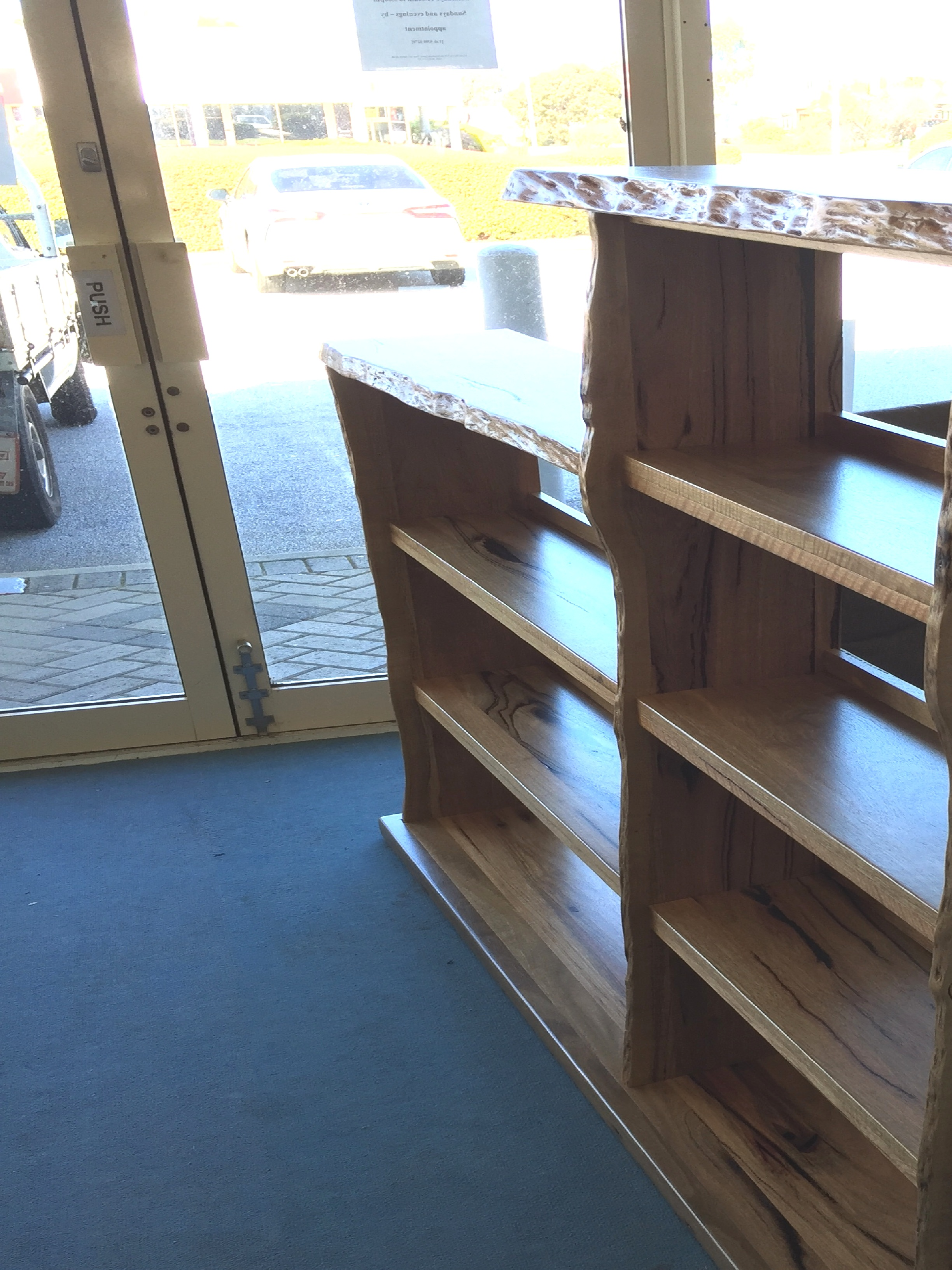 Marri natural edge custom bookcase