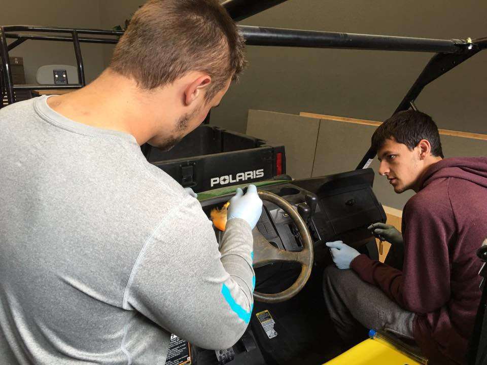 Students working on an off-road vehicle