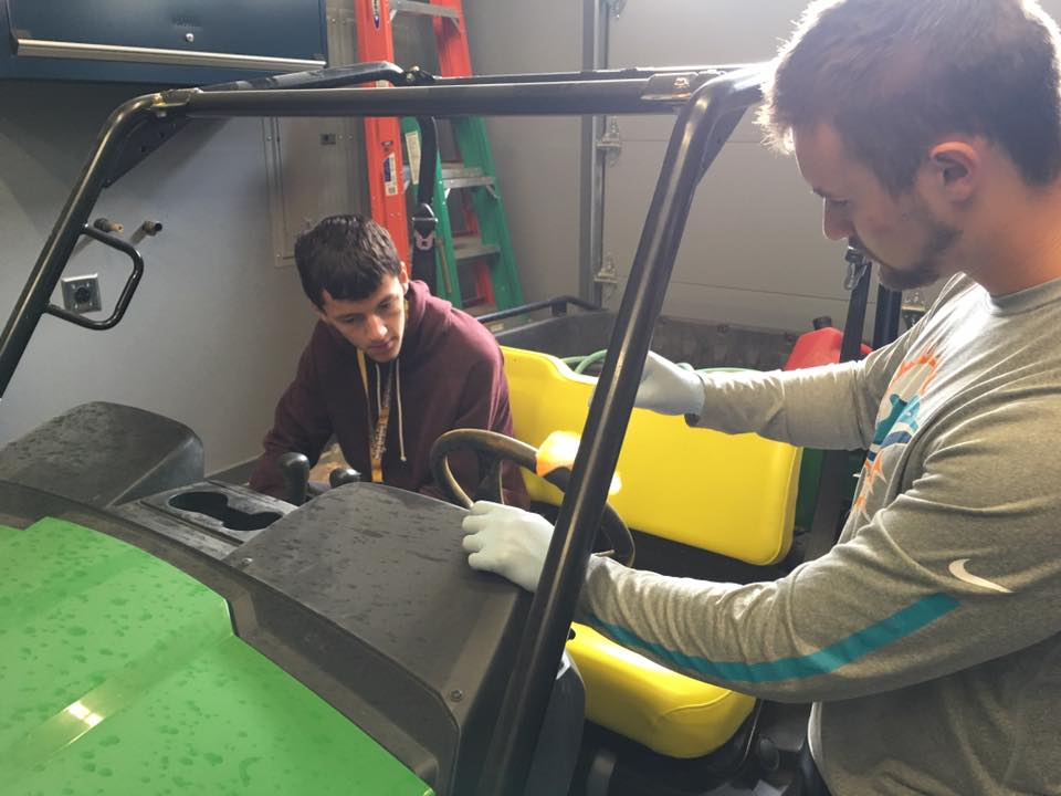 Students learn how to maintain an offload vehicle.