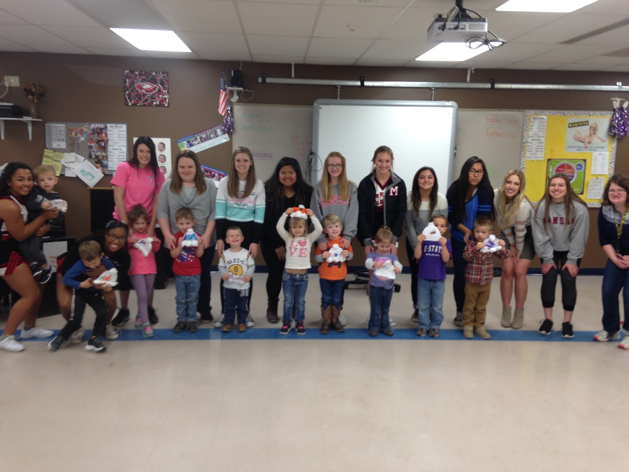 Maize High students and their new friends at a Maize elementary school.