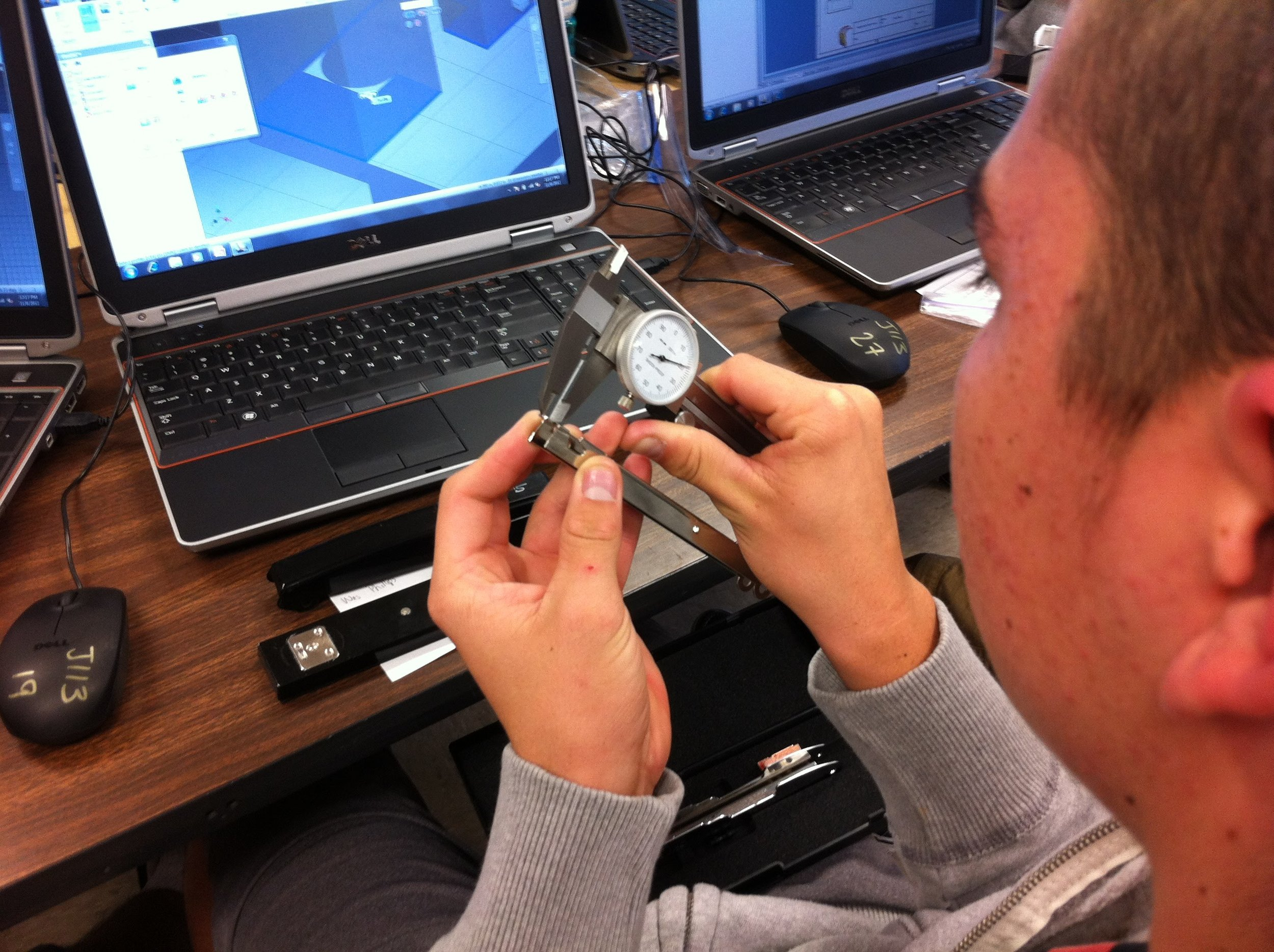 Engineering Student measures an object