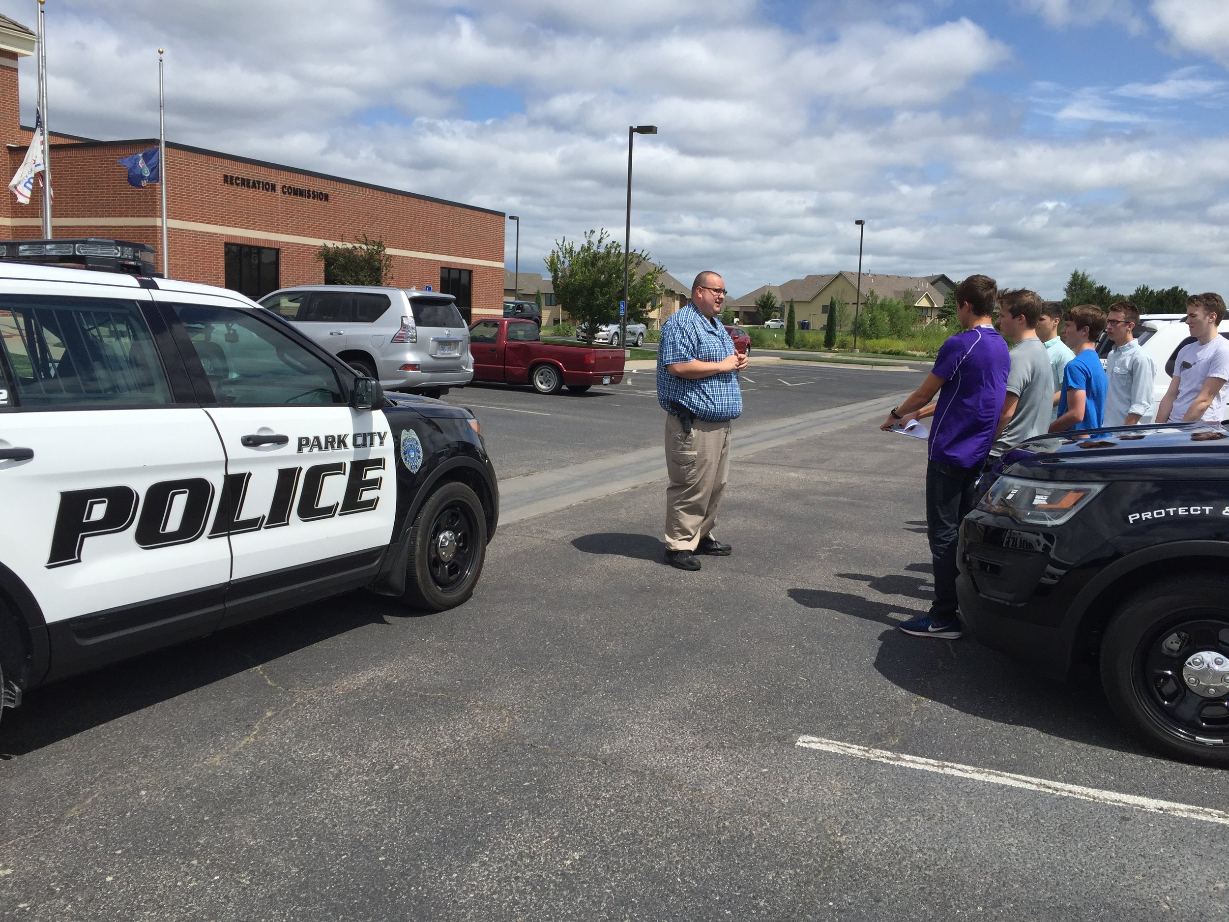 Park City Law Enforcement officer explains police car technology to students